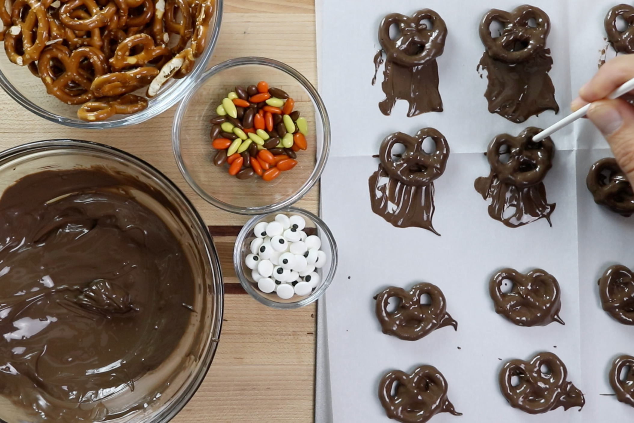 5. Gently move the pretzels up on the baking sheet to remove excess coating. -