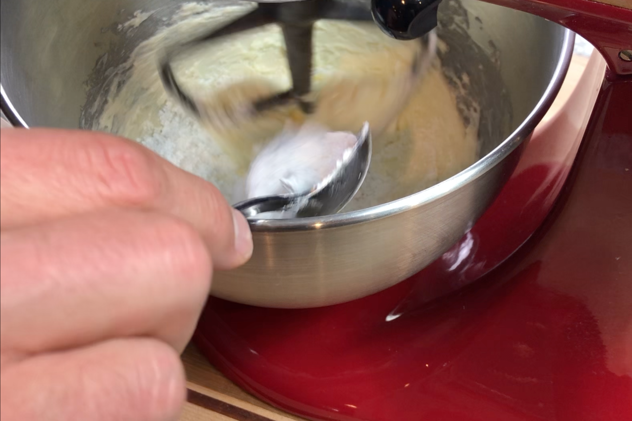 3. While mixing on low, slowly add the powdered sugar. Mixture will be clumpy. -