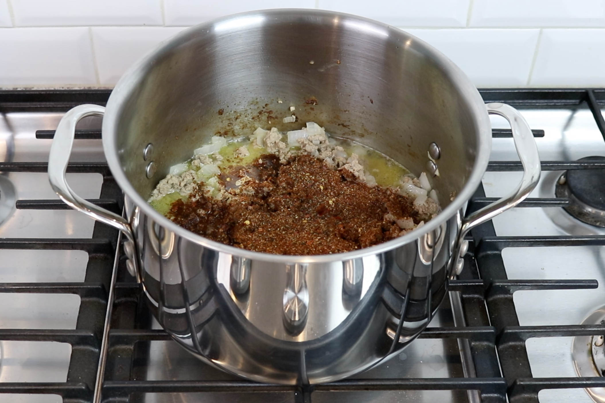 4. Turn stove to medium and add the water and chili seasoning mix. Bring to a boil. -