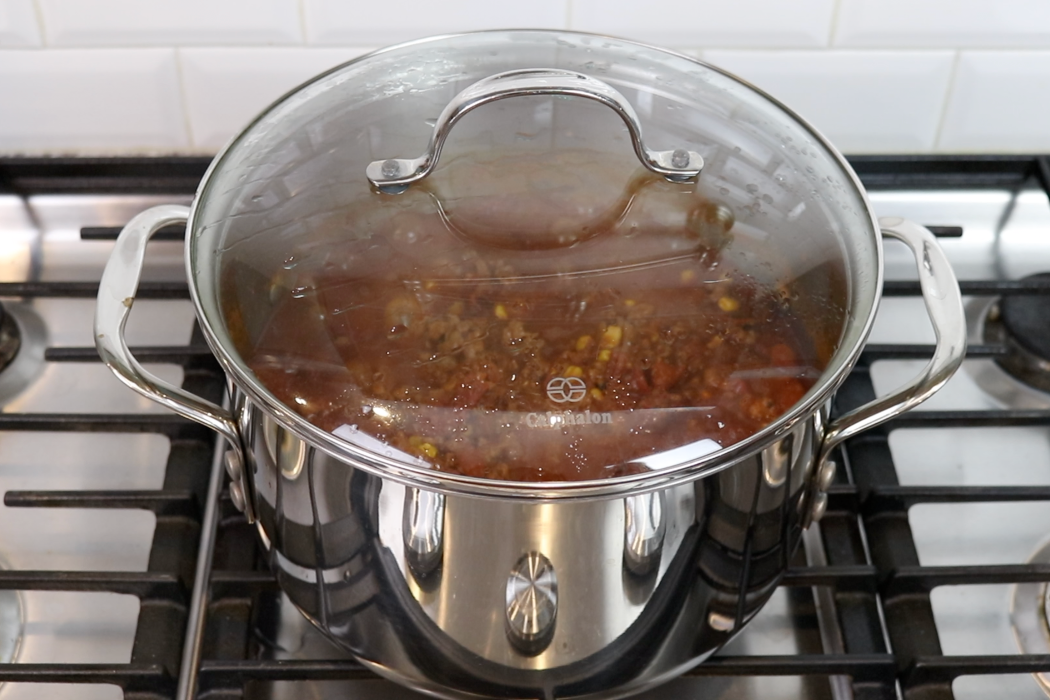 7. Cover and let simmer for an hour or two. -