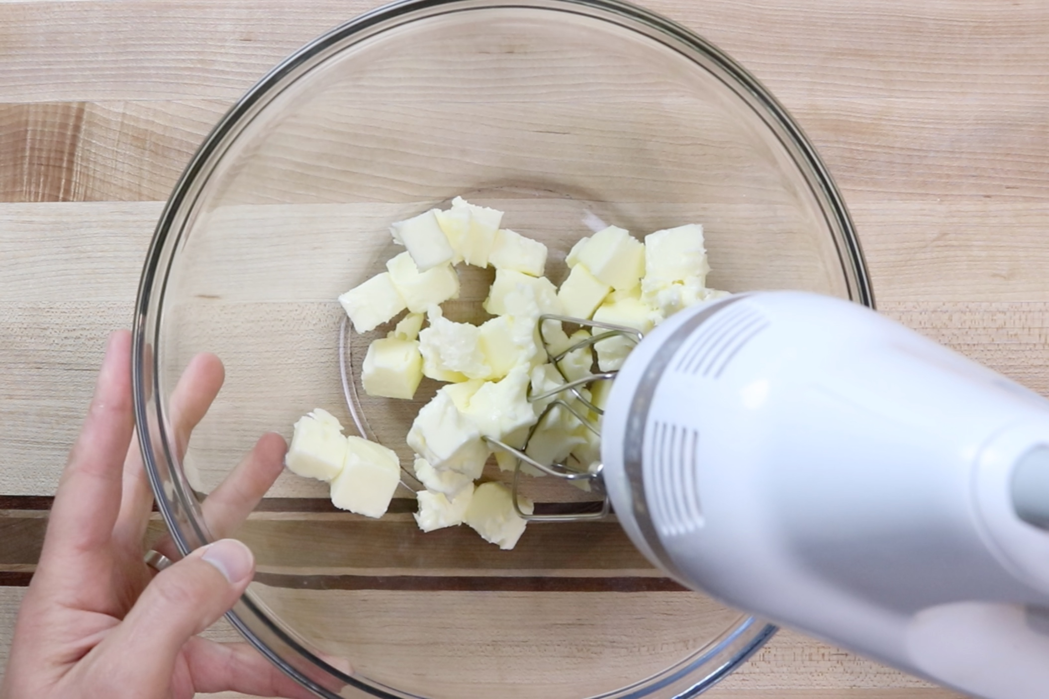 2. In a large bowl with a hand mixer or the bowl of a stand mixer, add butter and beat until creamy. Scraping down the sides when necessary. -