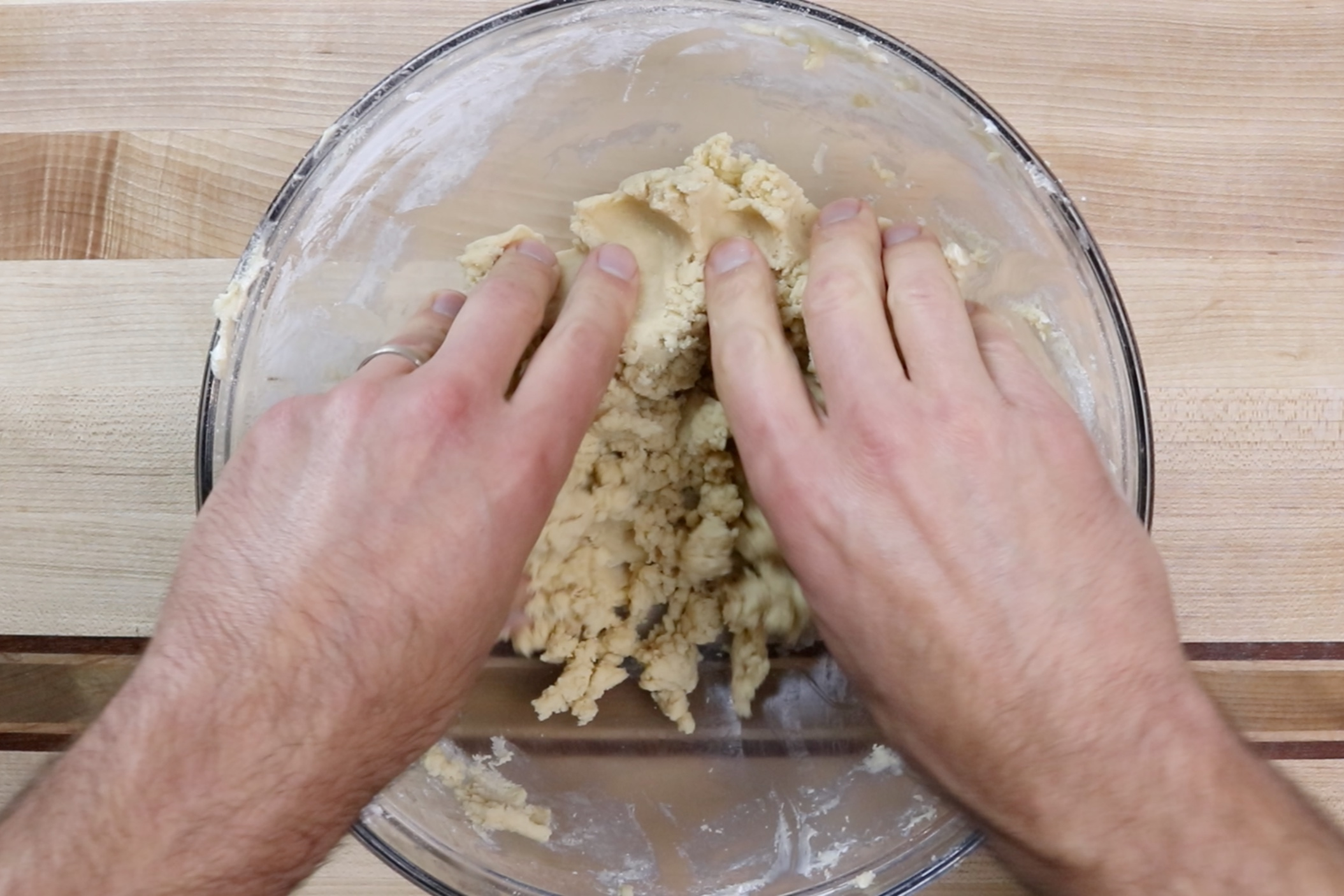 6. Use your hand at the end to make sure it stays together. Add a small amount of milk to the dough if it is too crumbly. -