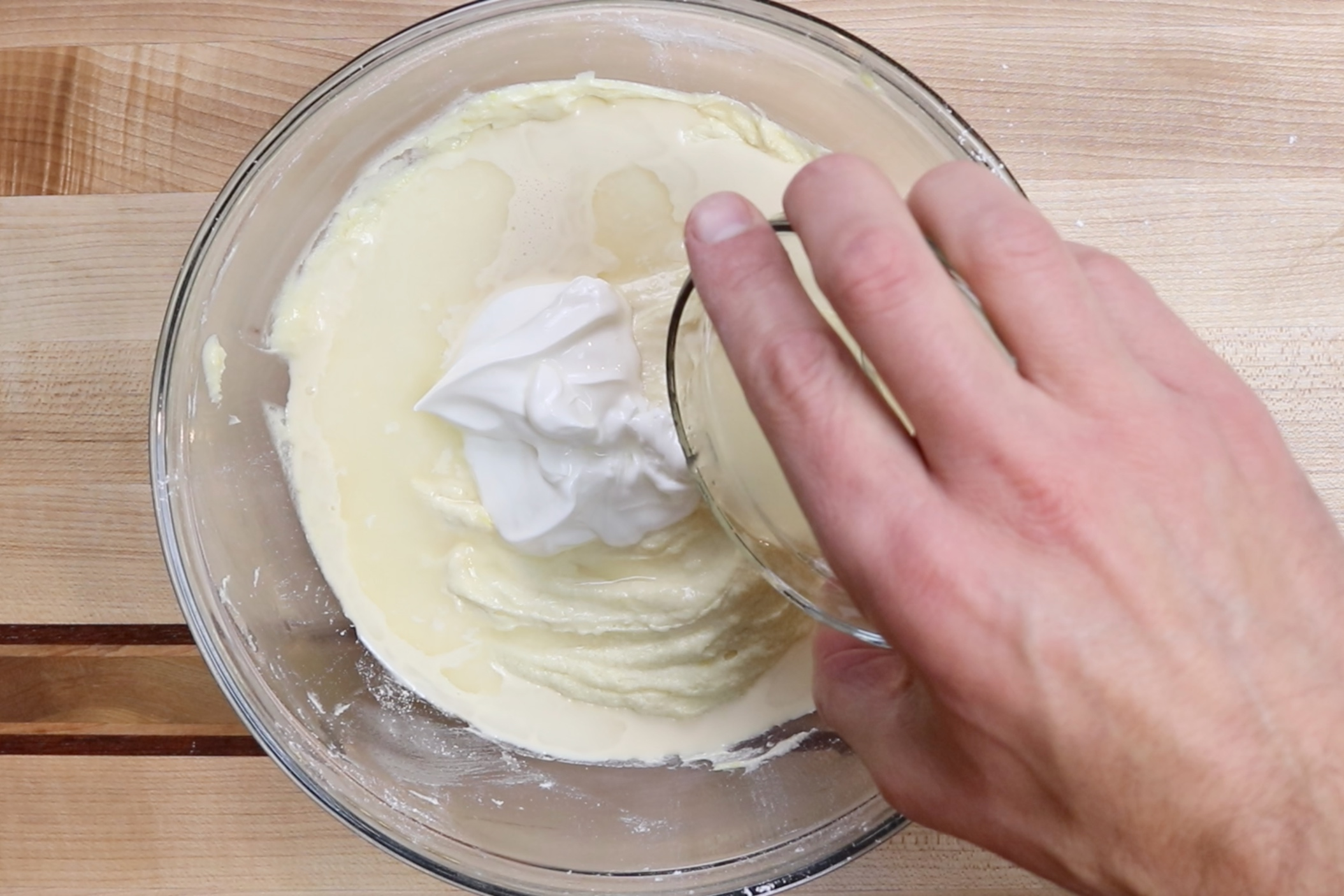 7. Stir in the milk, sour cream and lemon juice. Mix until combined. -