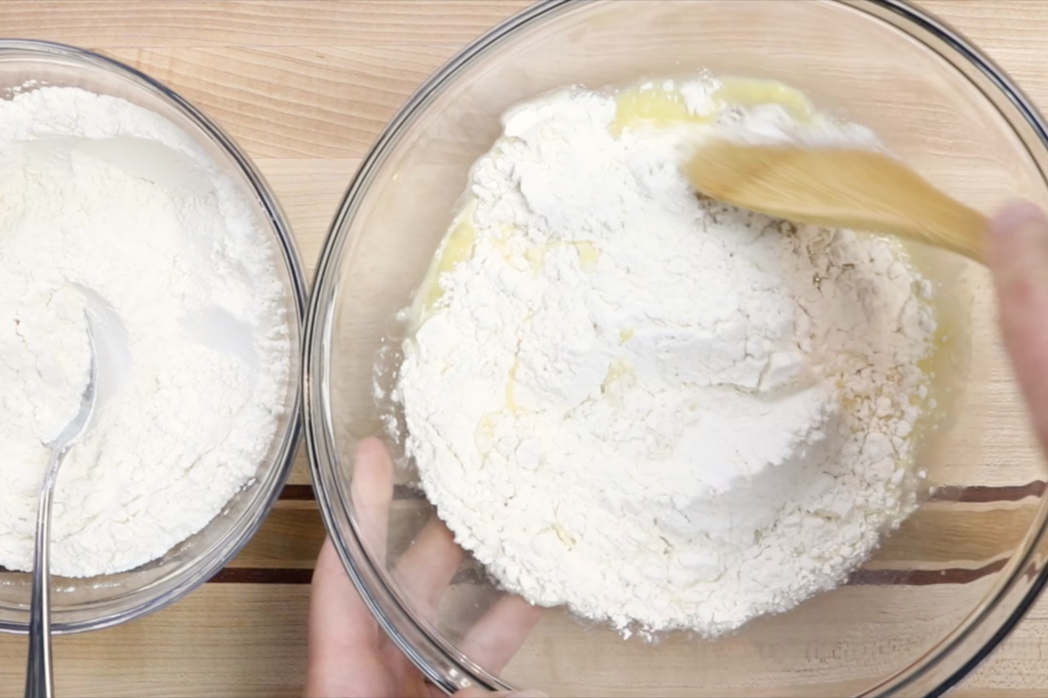 6. Slowly add the flour and mix with a large spoon or the paddle attachment for your mixer. -