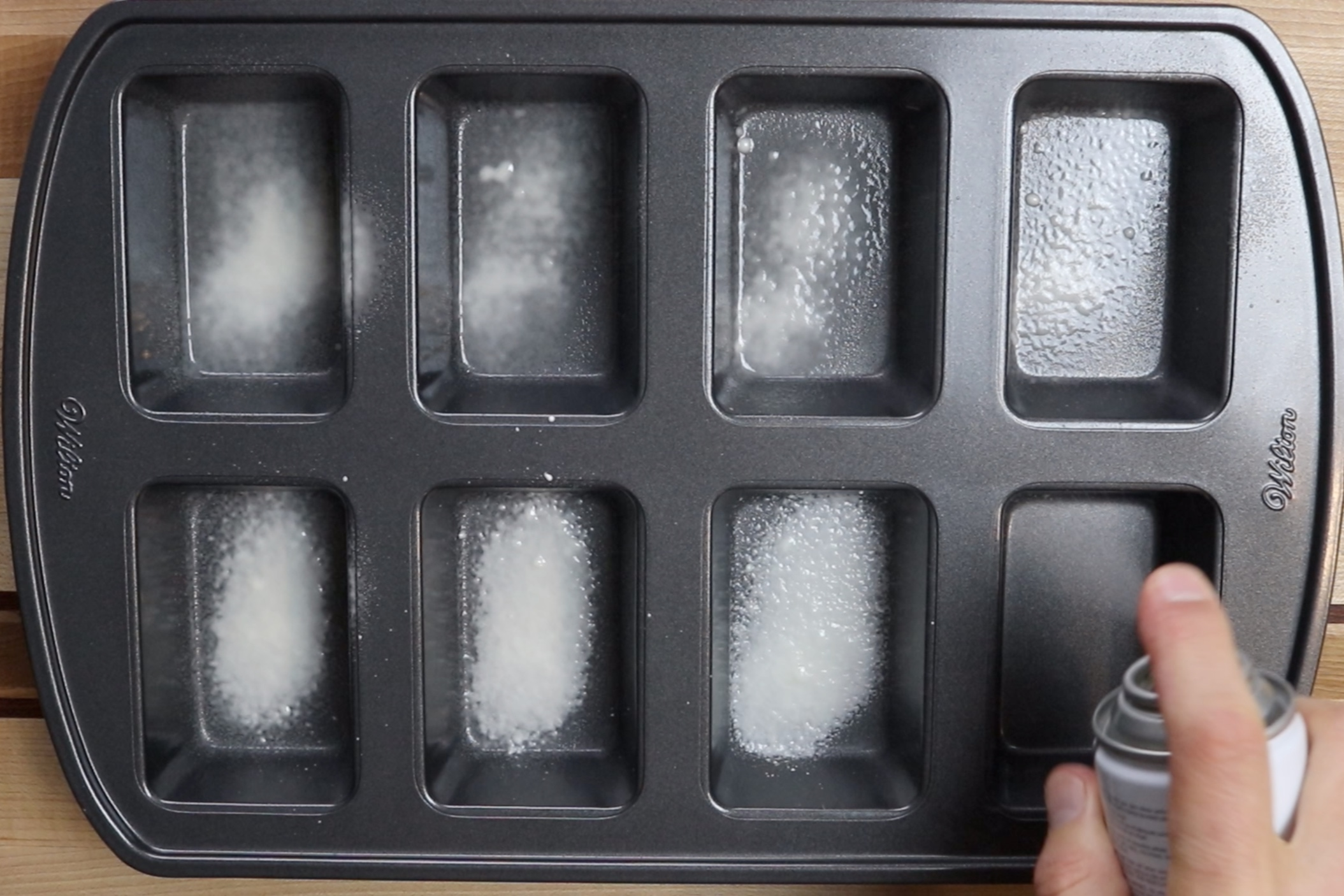 1. Pre-heat oven to 350 degrees and grease an 8 count mini-loaf pan. -