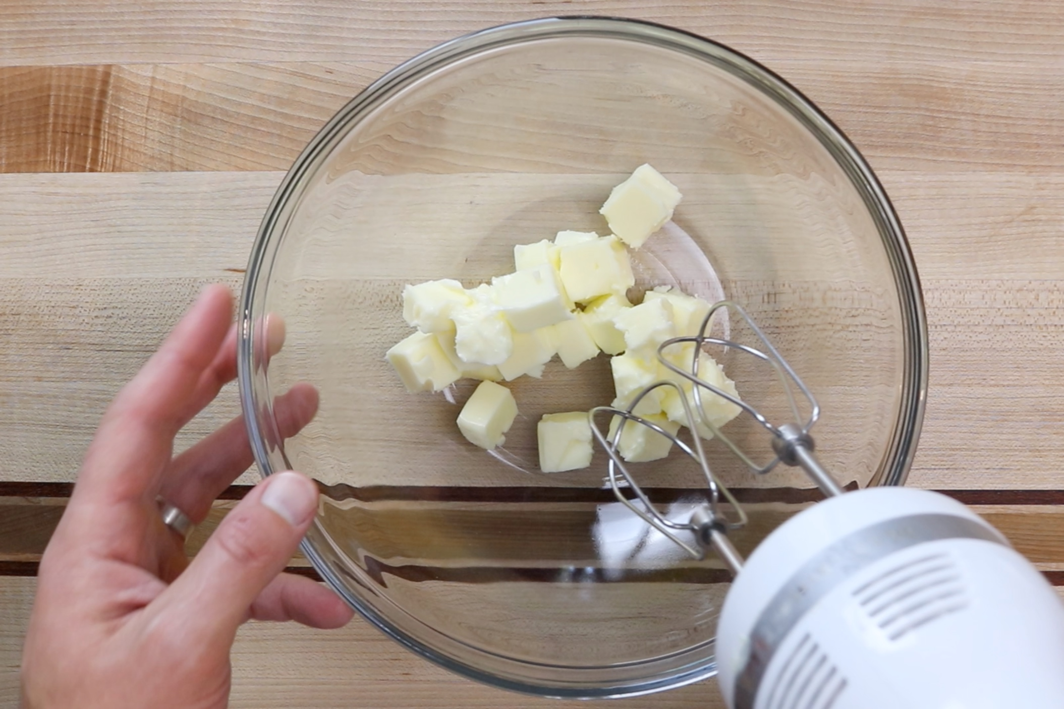 5. Add softened butter to a large bowl or the bowl of a stand mixer. Beat until smooth. -