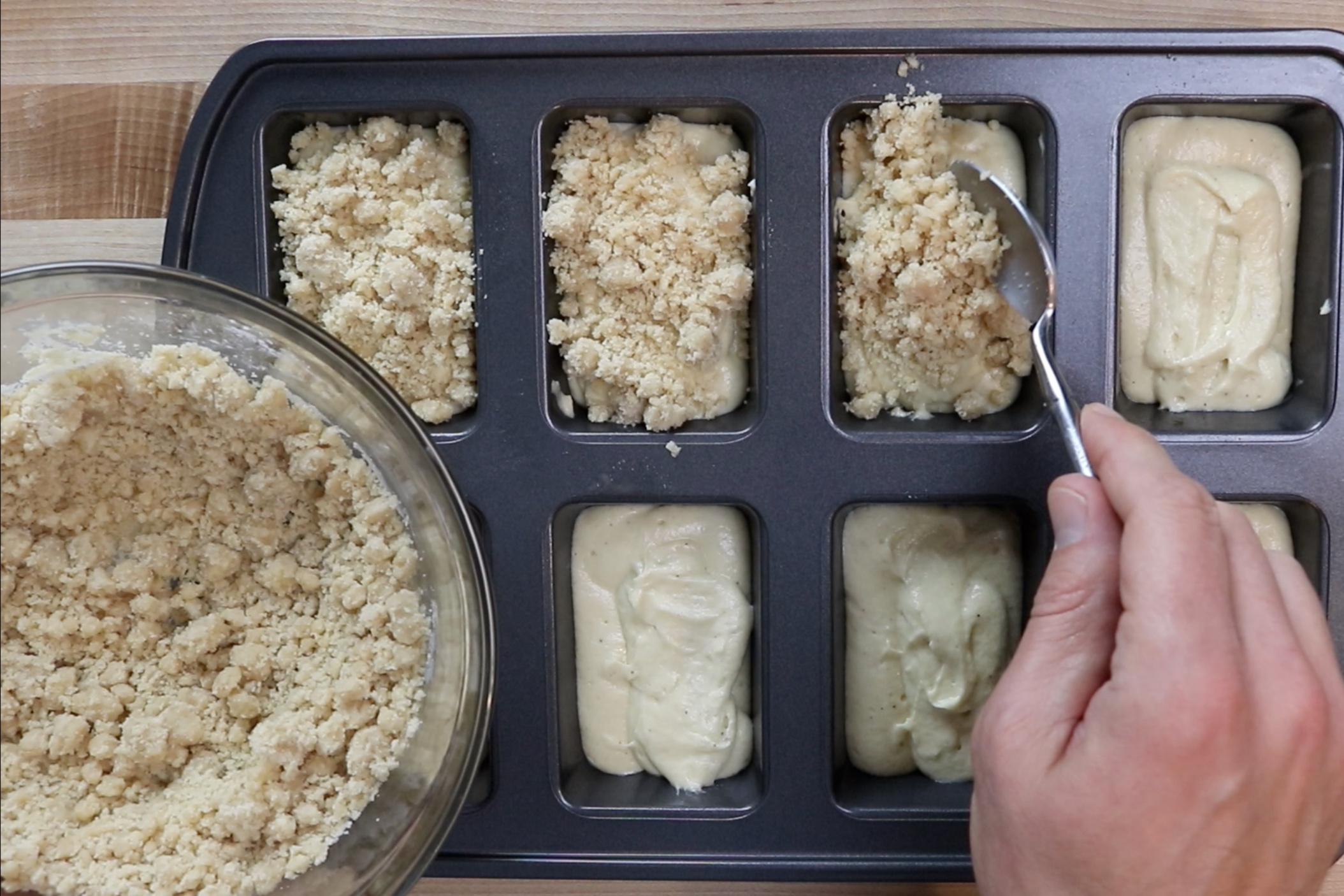 12. Sprinkle topping over the loaves. -