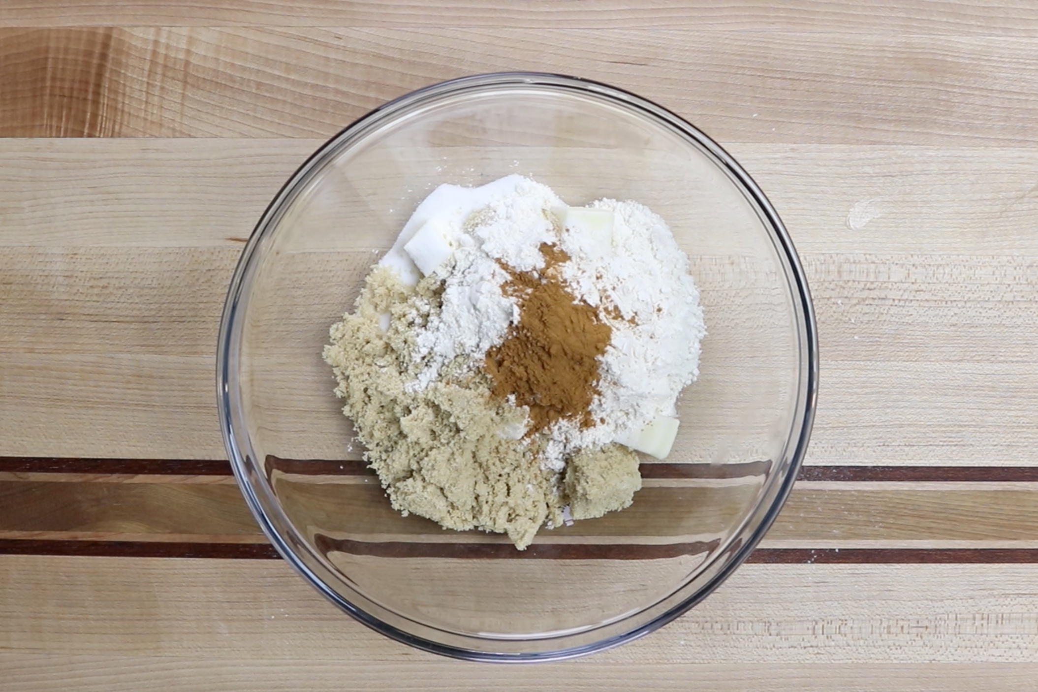 2. Prepare the topping. In a medium bowl, combine butter, sugar, brown sugar, flour and cinnamon. -