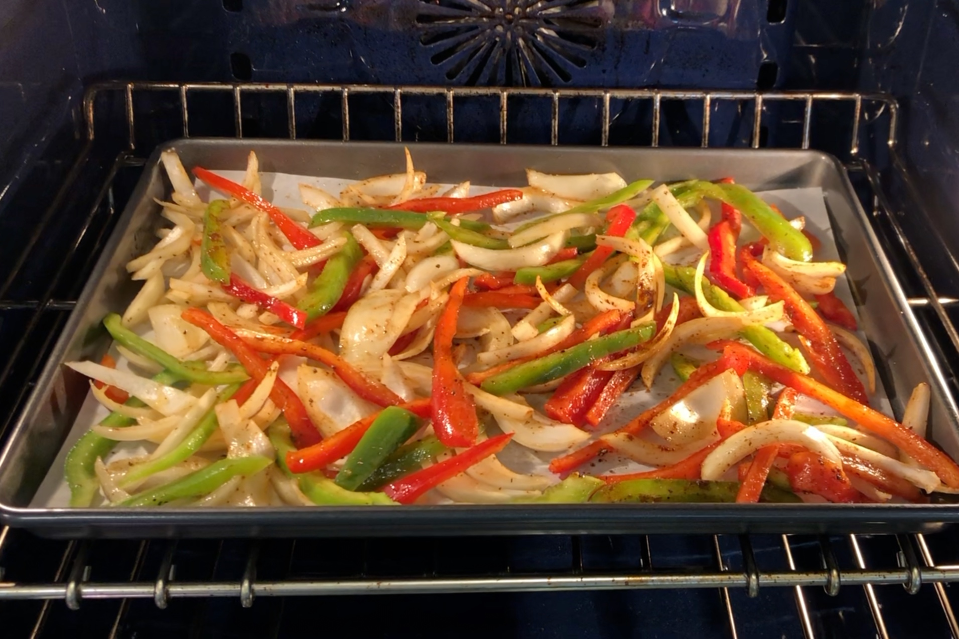 7. Spread veggies evenly on the baking sheet. Cook for 10 minutes. -