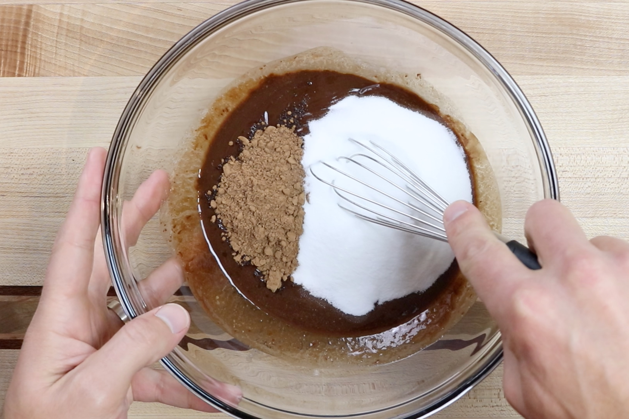5. Add the cocoa powder and sugar to the melted chocolate. Stir until combined. -