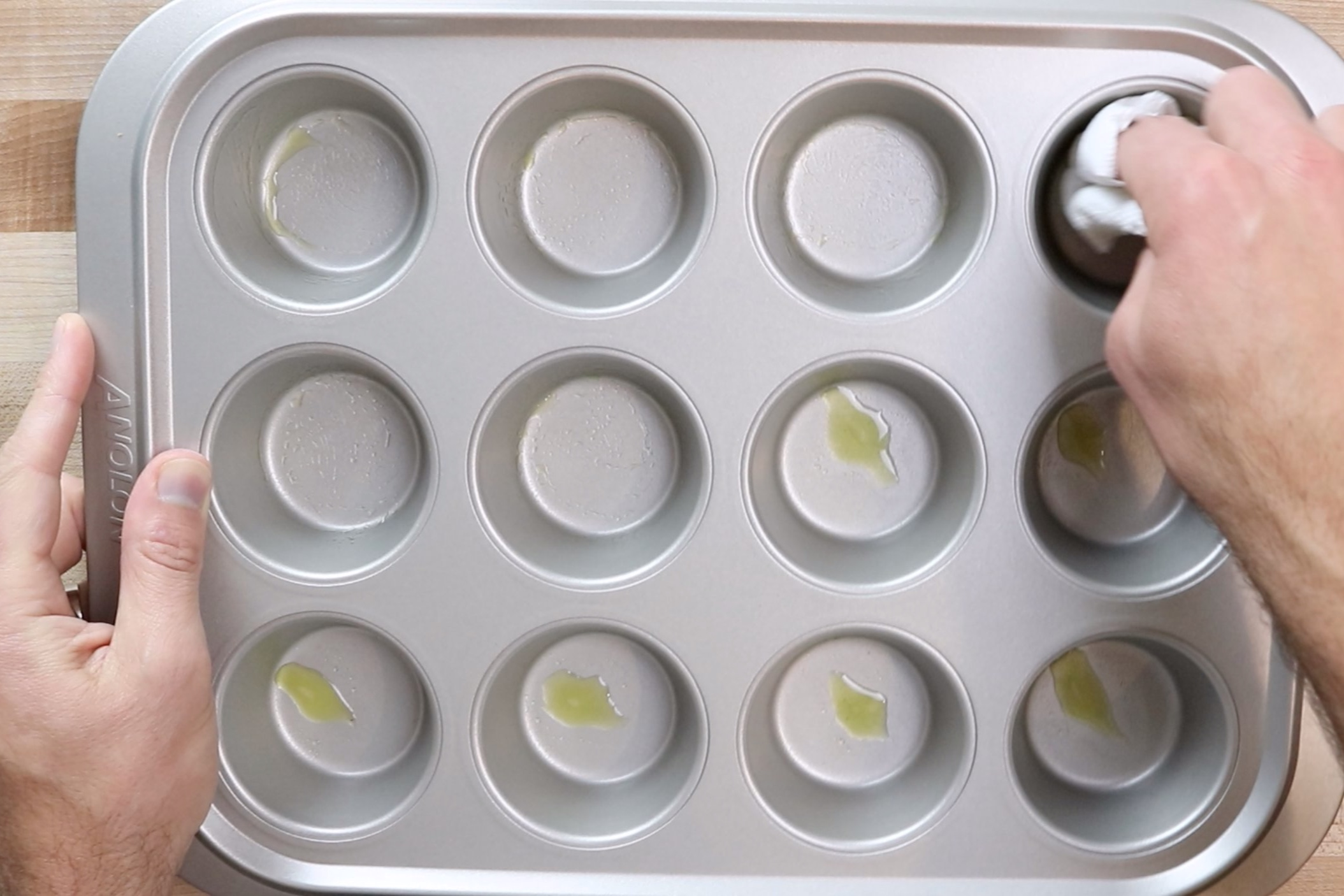 1. Preheat oven to 350° and grease a muffin tin with cooking spray. -