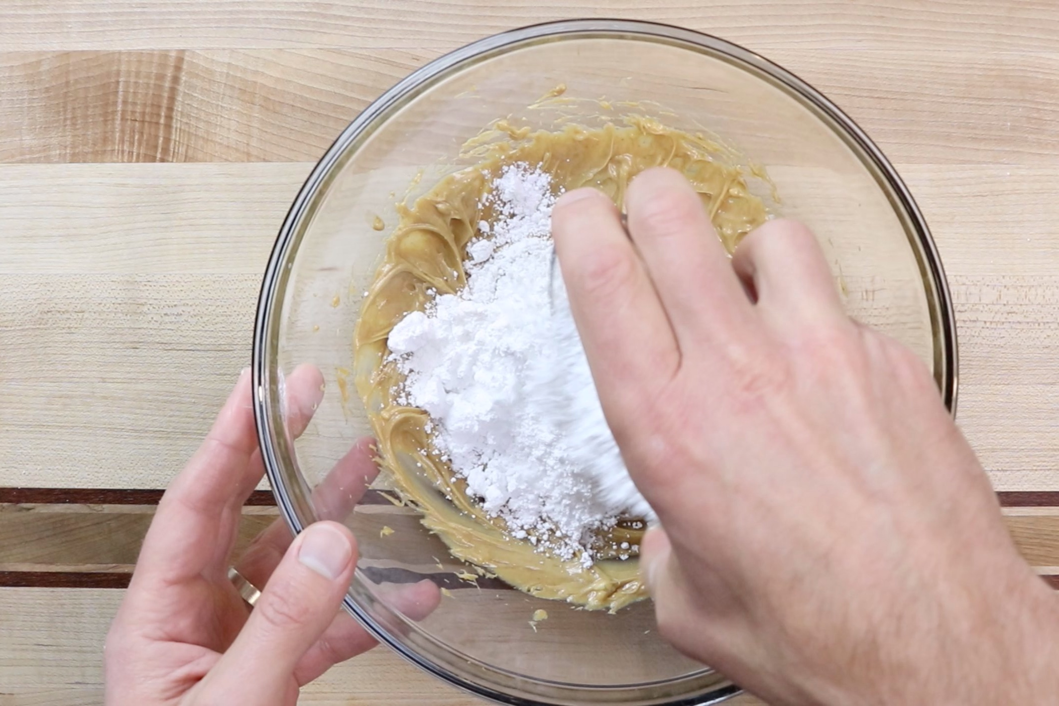 10. Add half of the powdered sugar and mix on low scraping down the sides when necessary. -