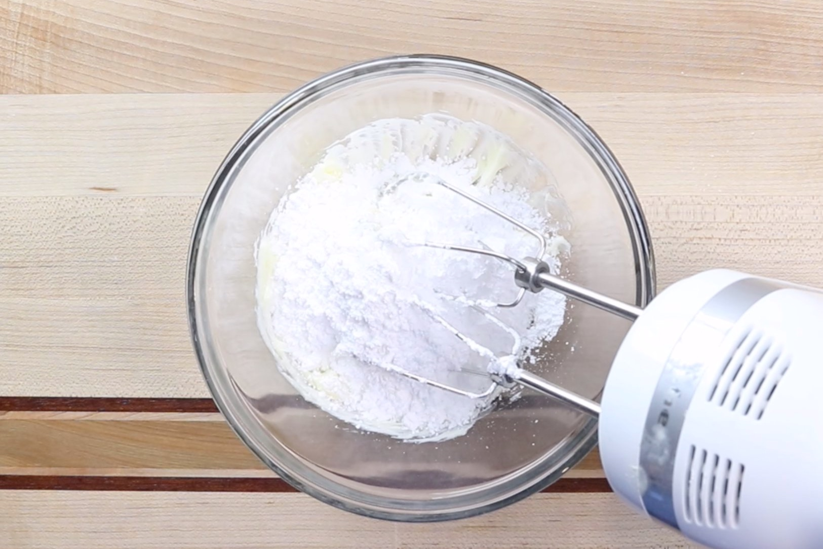 7. In a medium bowl, beat the butter until smooth and creamy.Add the powdered sugar and continue mixing, scraping down the sides when necessary. Mixture will be dry and crumbly. -