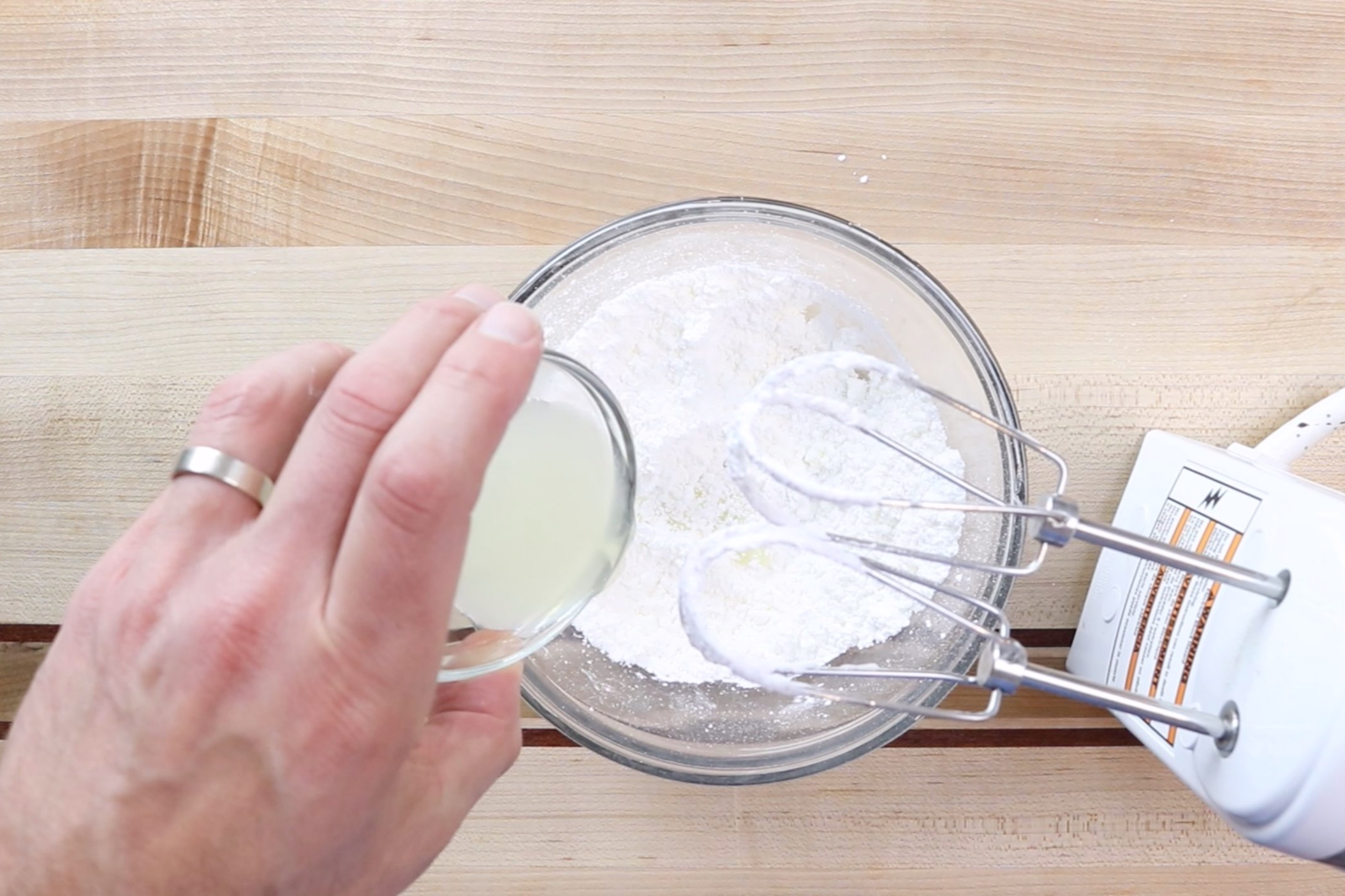8. Add the lemon juice slowly until desired consistency is reached. -
