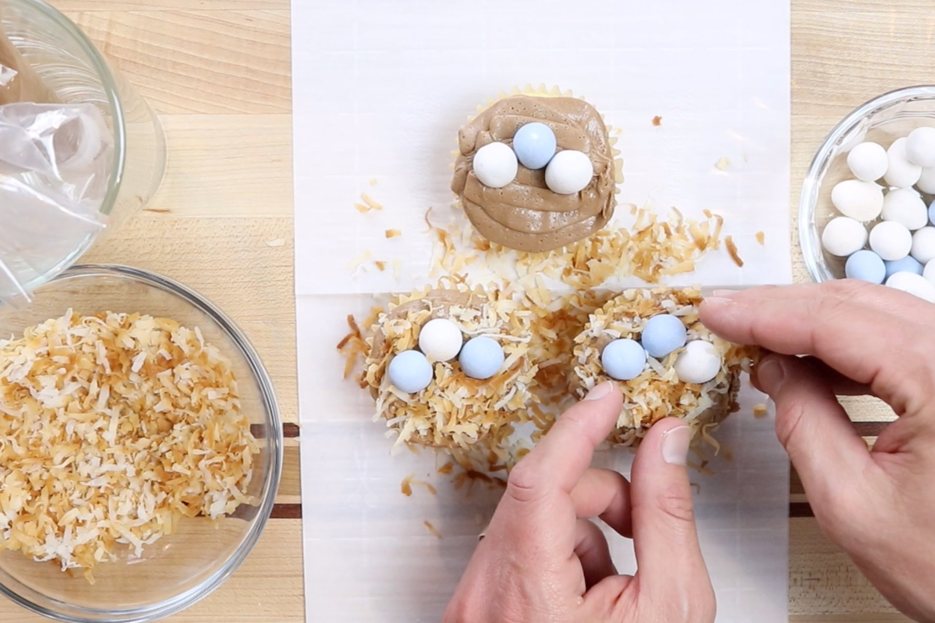 5. Sprinkle the toasted coconut around the cupcake filling in all the frosted area. -