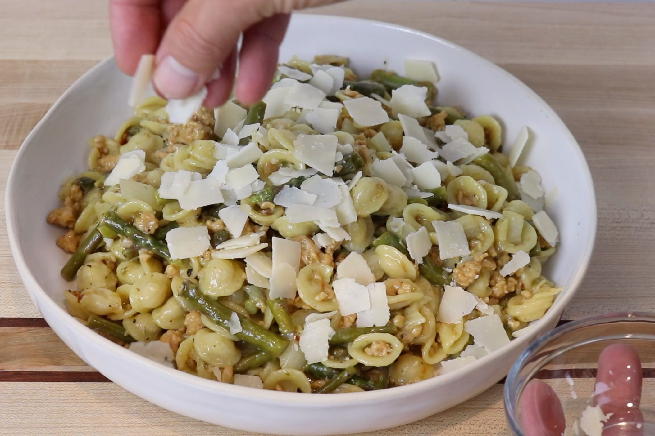 9. Remove from heat. Transfer to a serving dish and sprinkle with Pecorino Romano cheese. -