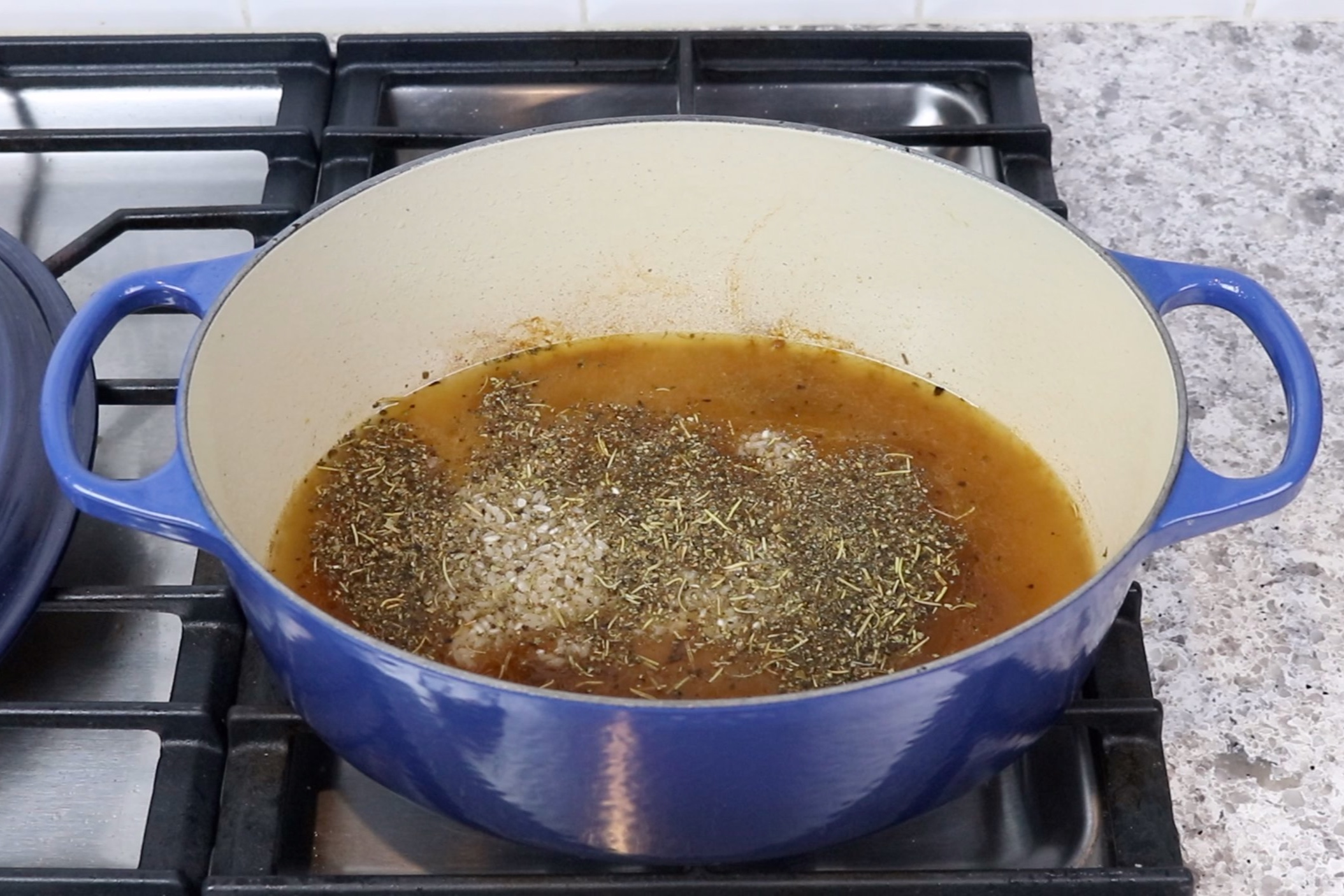 7. Add chicken broth, rice and remaining seasoning to the pot or pan. Bring to a boil over medium-high heat. -