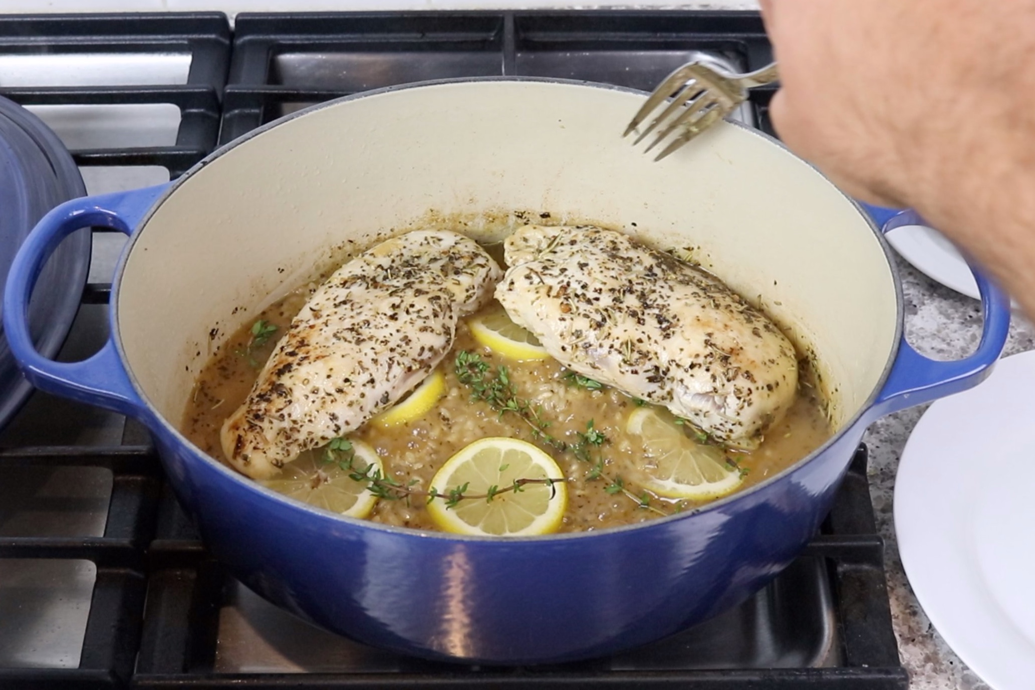 9. Uncover...stir rice and place chicken, lemon slices and fresh thyme on top of the rice. Cover and simmer another 10-15 minutes until liquid is dissolved. -