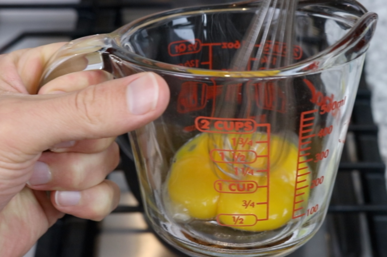 1. In a medium bowl or measuring cup, whisk the egg yolks and set aside. -