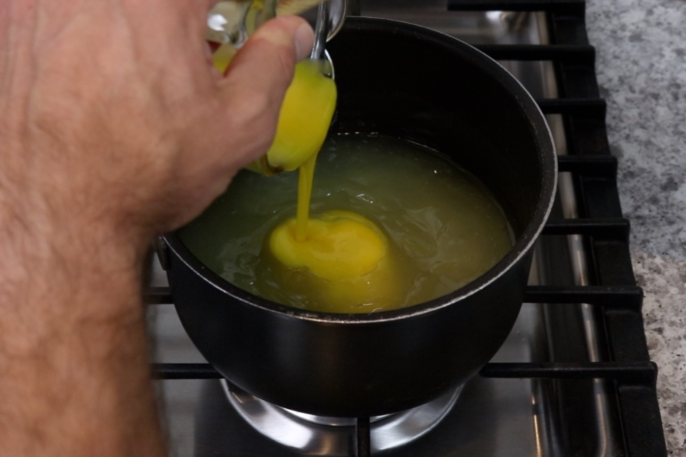 4. Reduce heat to low. Add a few tablespoons of hot mixture to the egg yolks. Whisk together and add to the saucepan. -