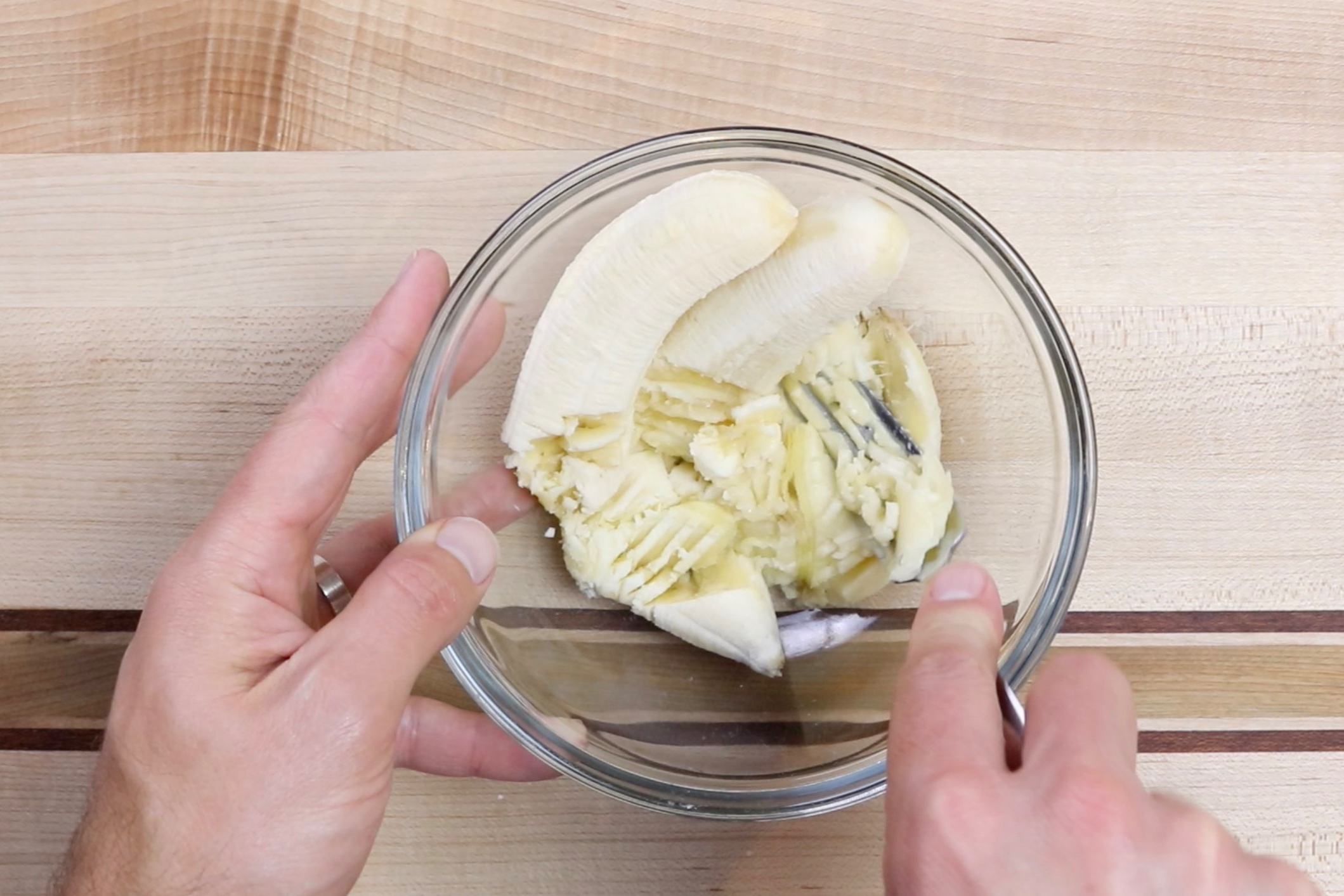 1. In a medium bowl, mash bananas with a fork. -