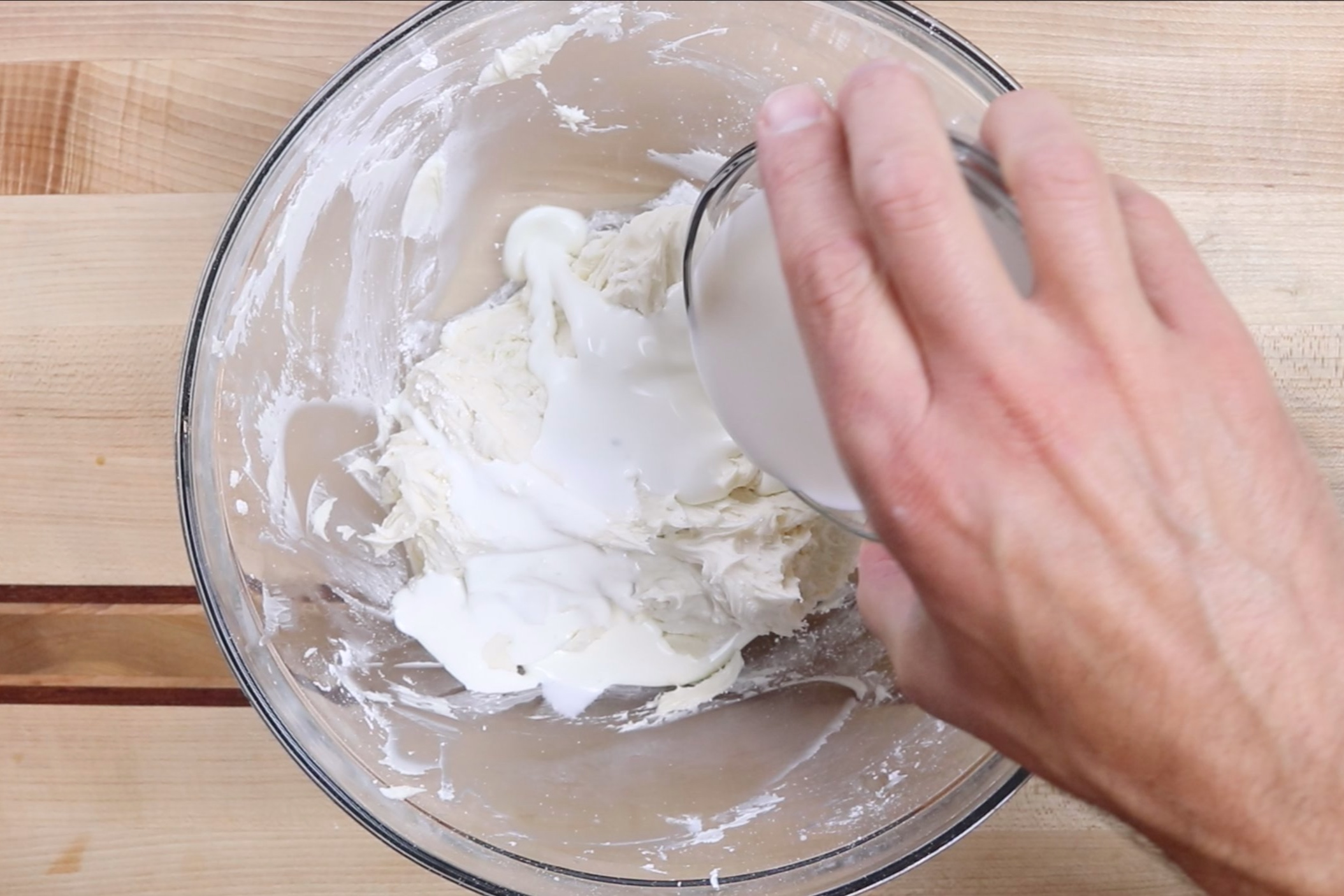 4. Add half of the heavy cream and mix until combined scraping down the edges when necessary. -