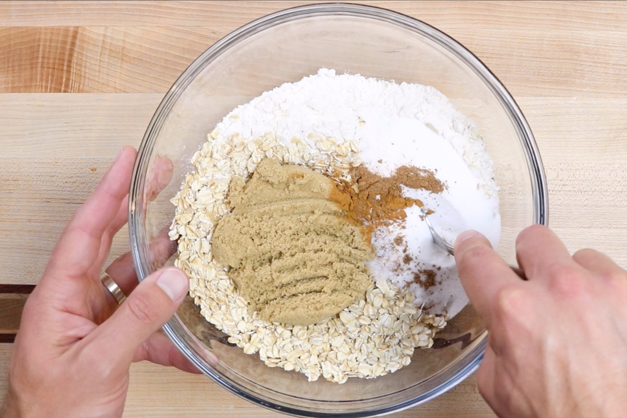2. In a large bowl stir together the flour, oats, sugar, brown sugar, cinnamon, nutmeg and salt. -