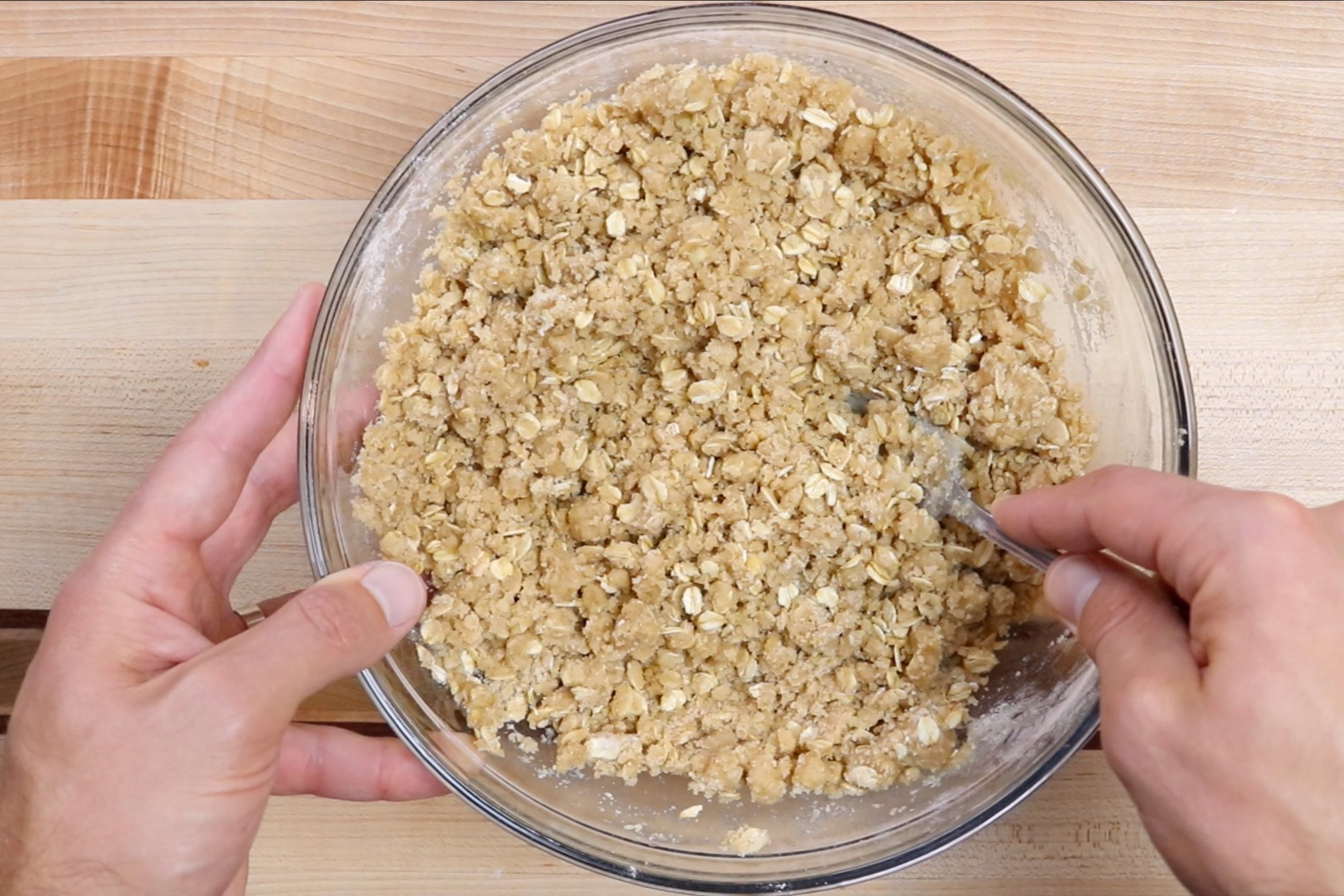 3. Add the melted butter and vanilla. Mix together with a fork or a pastry cutter into a crumble-like mixture. -