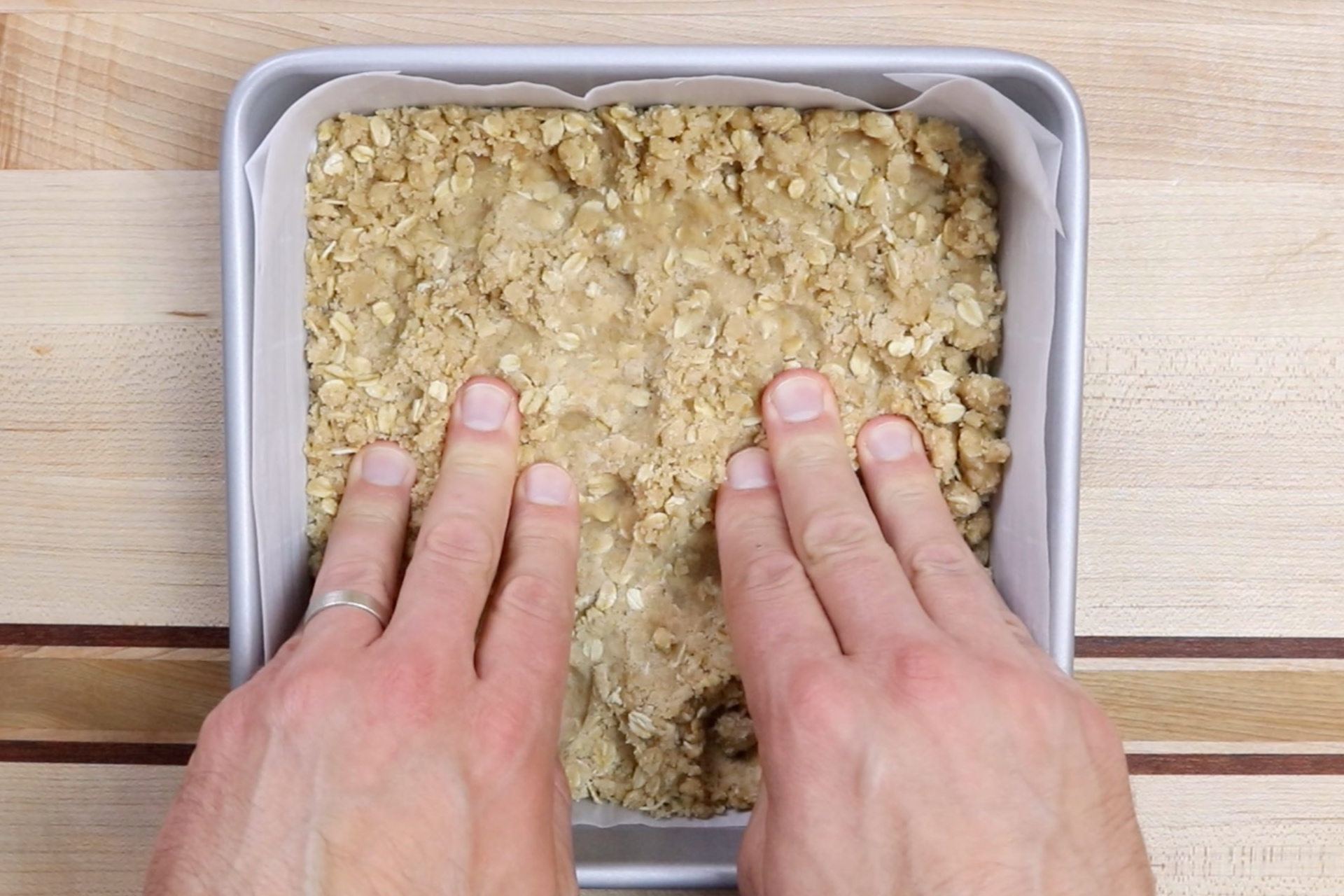 4. Set aside 1 1/2 cups of the crumble mixture, then press remaining crumble into the bottom of your baking dish. Bake for 10 minutes. -