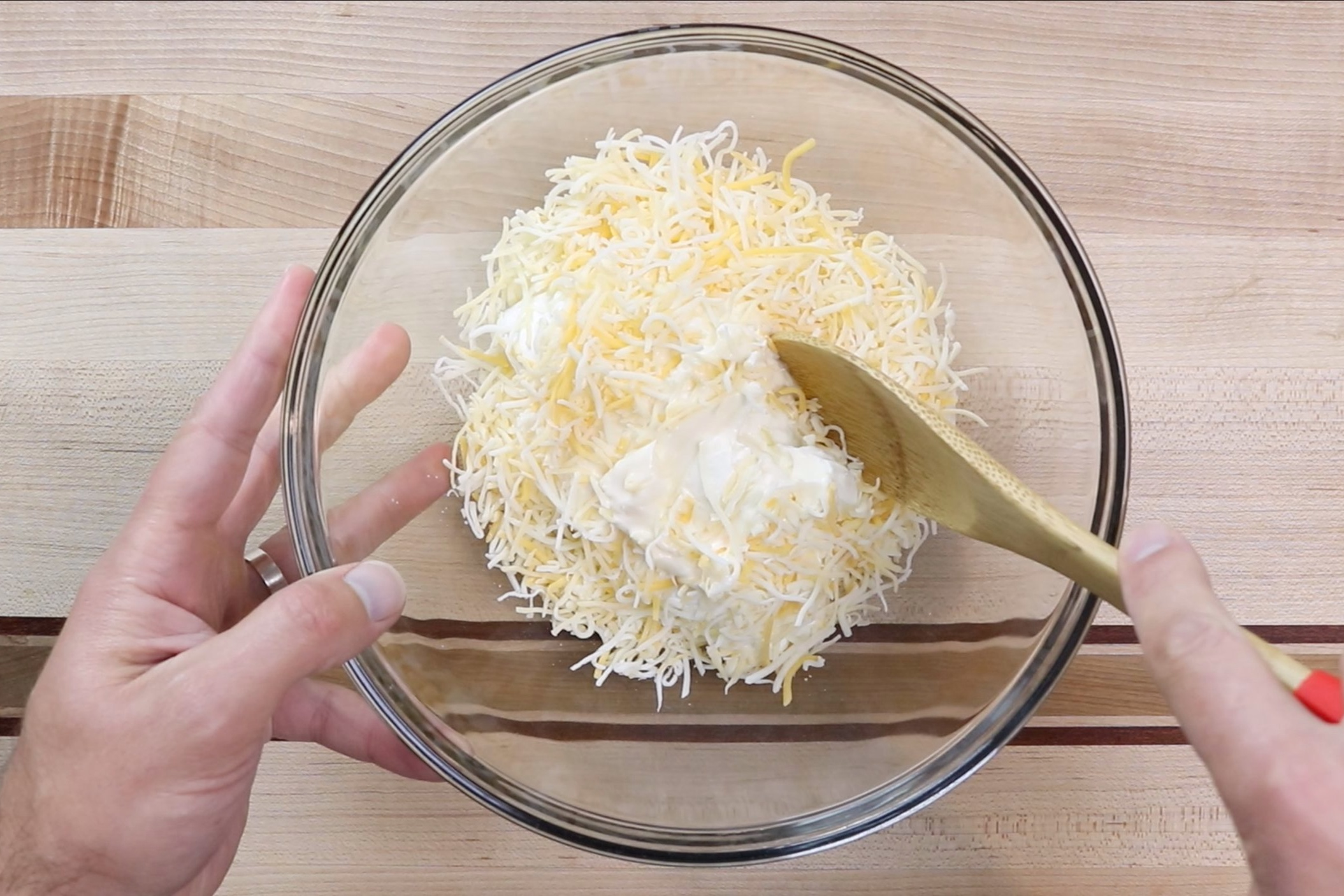 2. Add the sour cream and shredded cheese and mix until combined. -