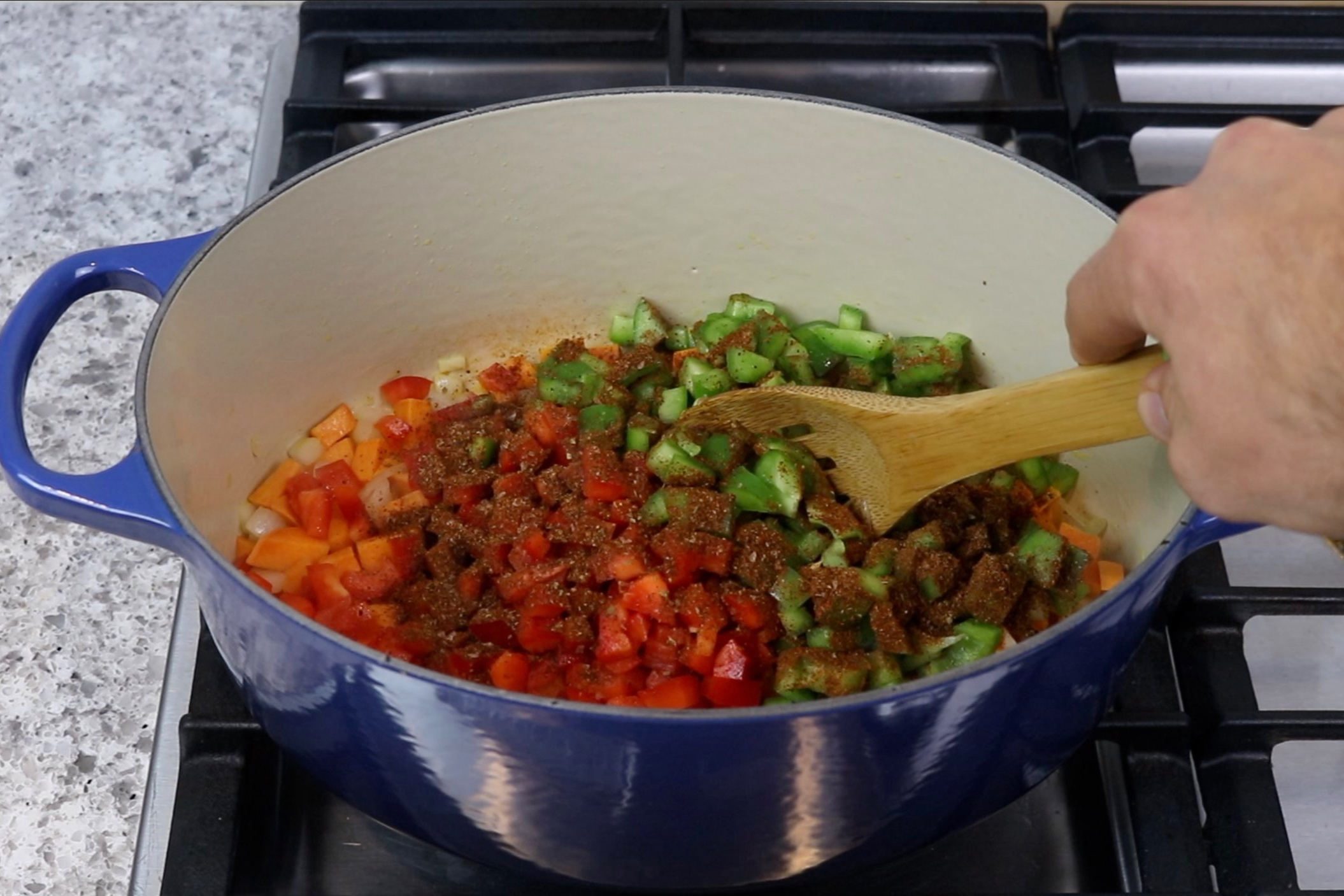 3. Add the garlic, red and green bell peppers, and Mexican spice mixture. Sauté for 3 minutes. -