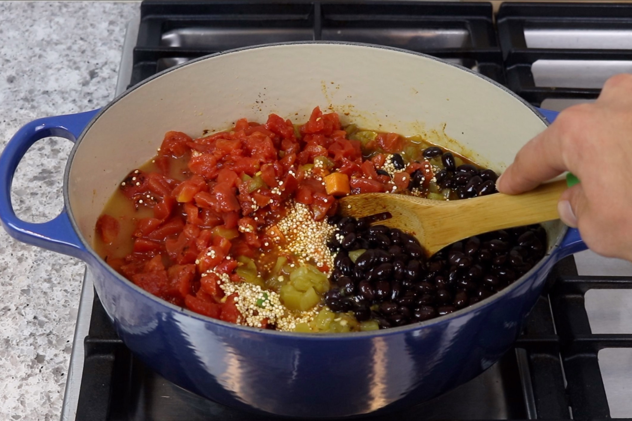 4. Add the quinoa, diced tomatoes, Rotel, black beans, green chilies and chicken broth. Stir to combine. -