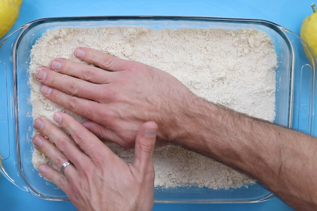3. Press dough onto bottom and up the sides of the baking dish using finger tips. Poke holes in crust with fork. -
