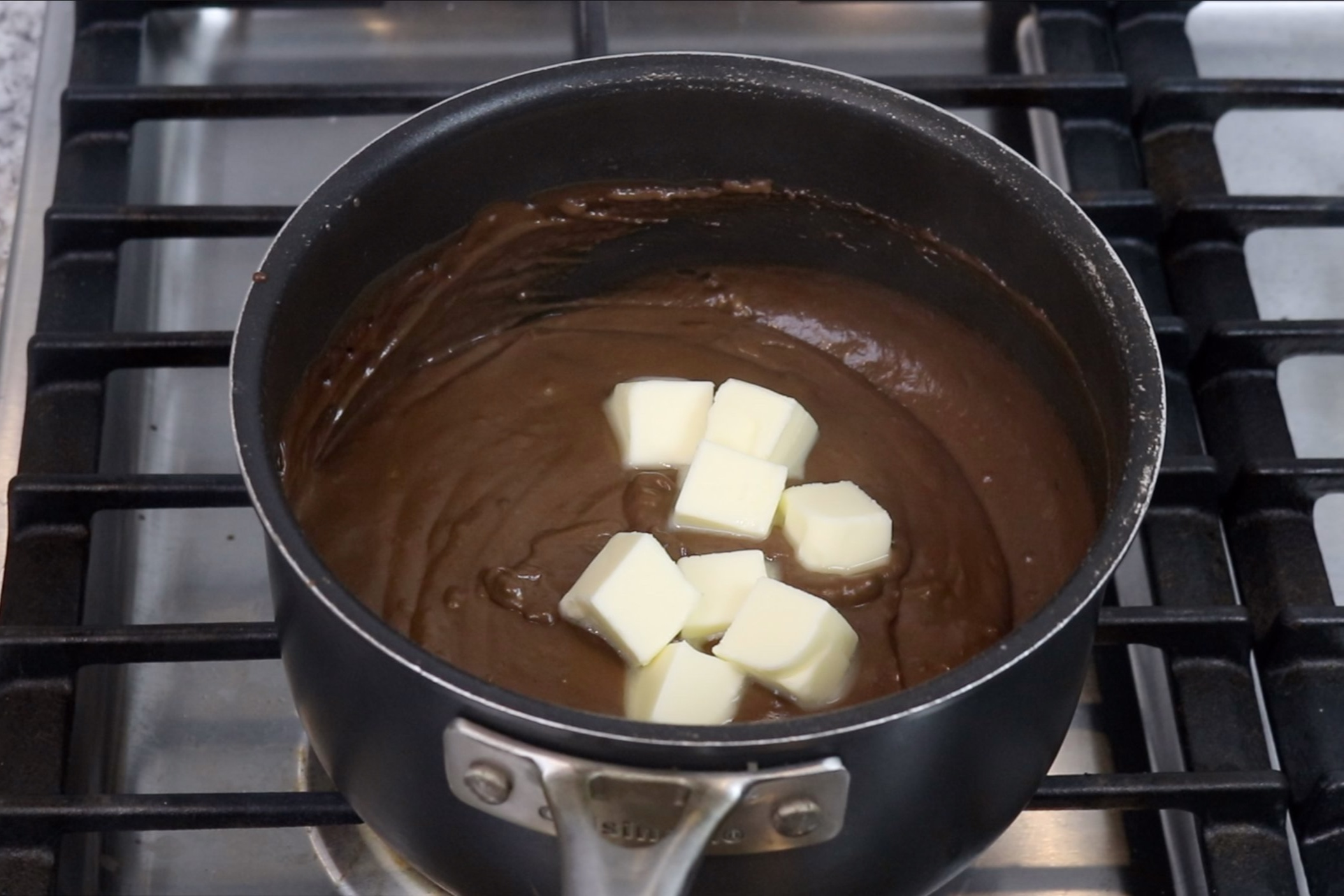 6. Remove from heat and stir in butter until completely melted. -