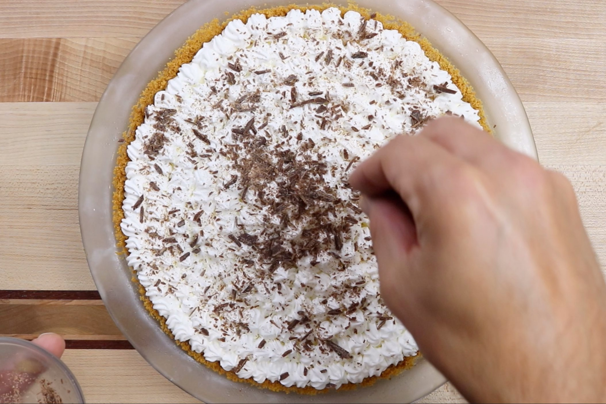 5. Sprinkle chocolate shavings on top of pie and put back in the refrigerator for at least an hour before serving. -