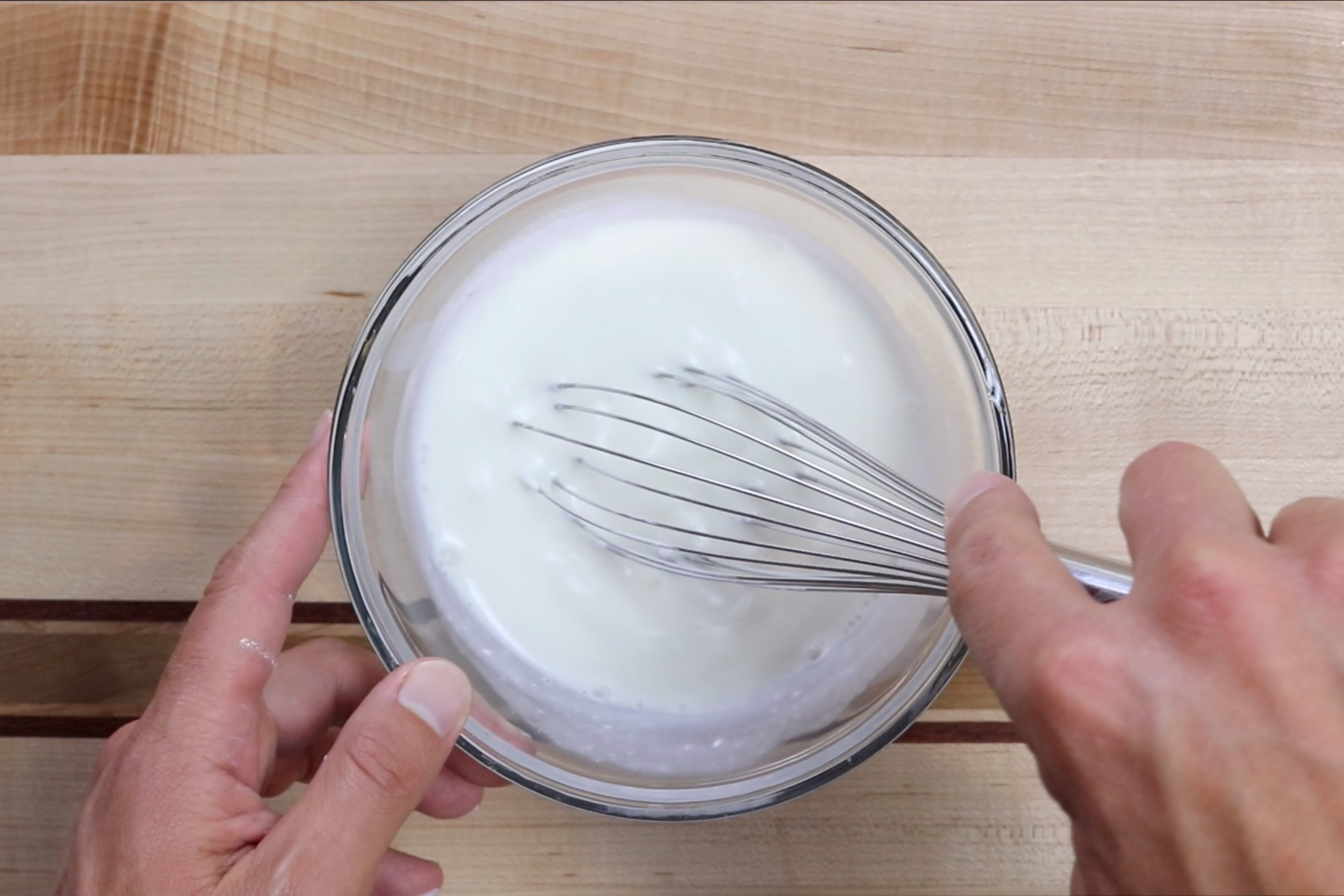 2. In a medium bowl, whisk together buttermilk and sour cream and set aside. -