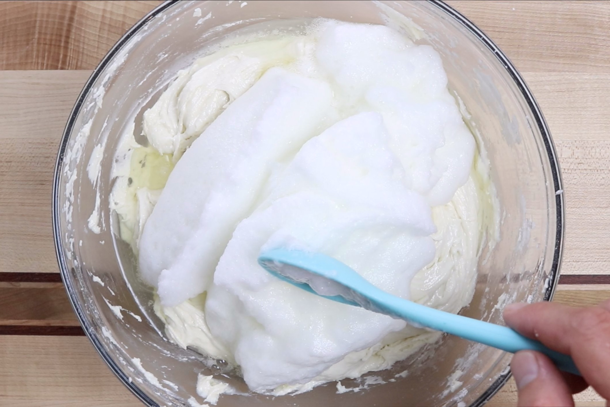 9. Gently fold egg whites into the batter until just combined. -
