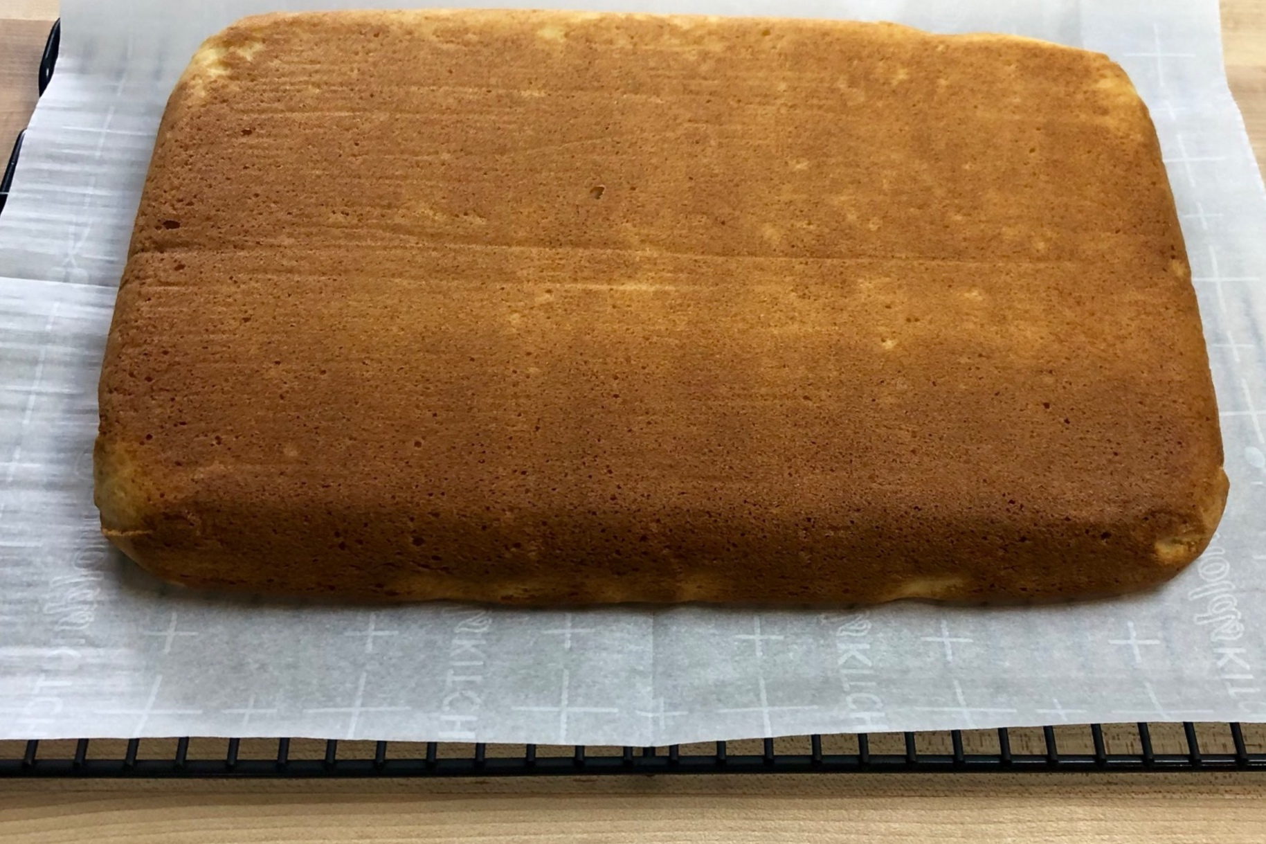 3. Using parchment paper, lift cake out of the dish and let cool completely on a wire rack. -