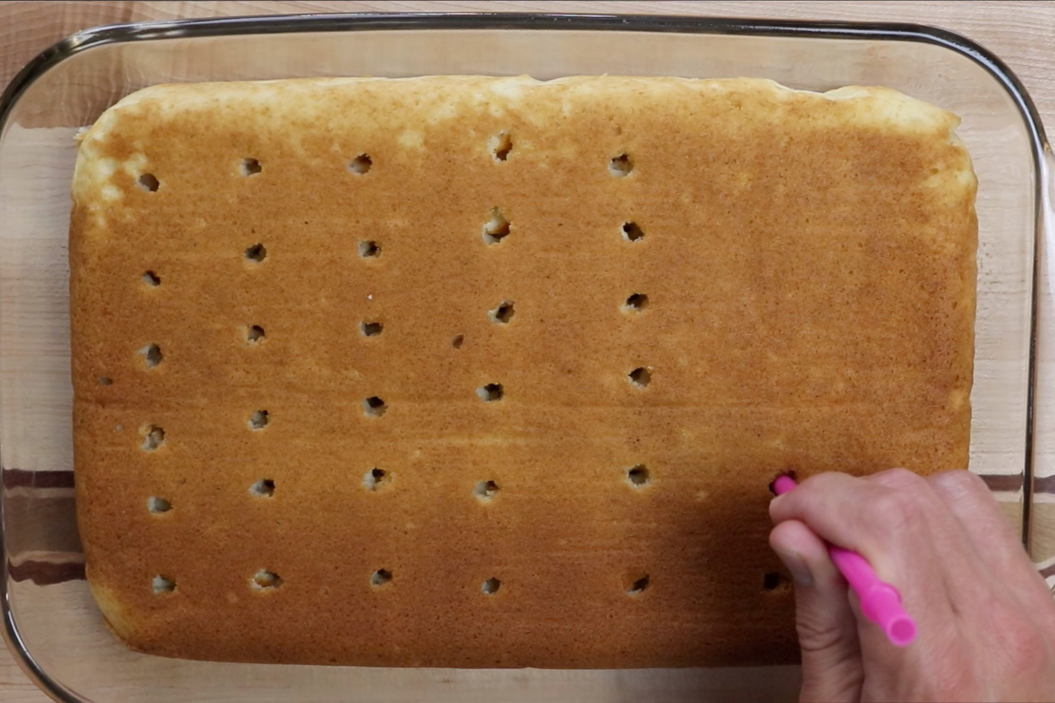 5. Using a straw or end of a wooden spoon, poke holes across the entire top. -