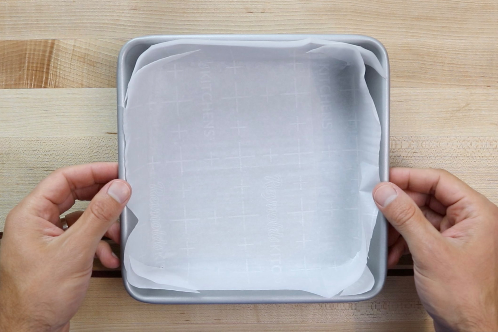 1. Preheat oven to 350 degrees. Line an 8x8 baking dish with parchment paper and set aside. -