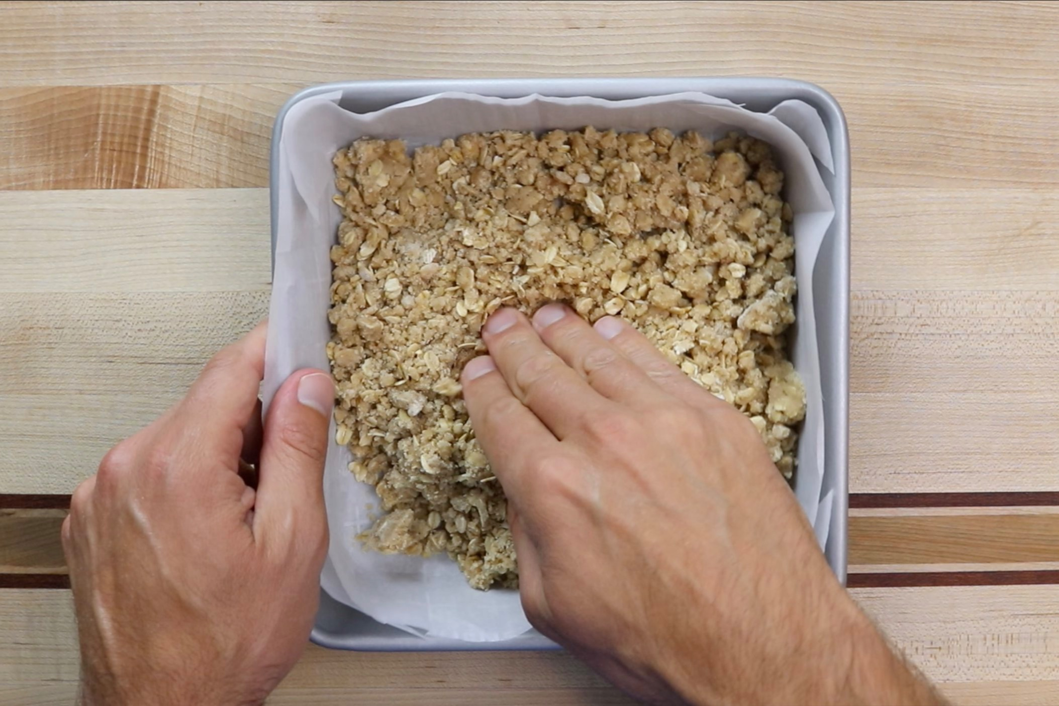 6. Press remaining crumble into the bottom of your baking dish. -