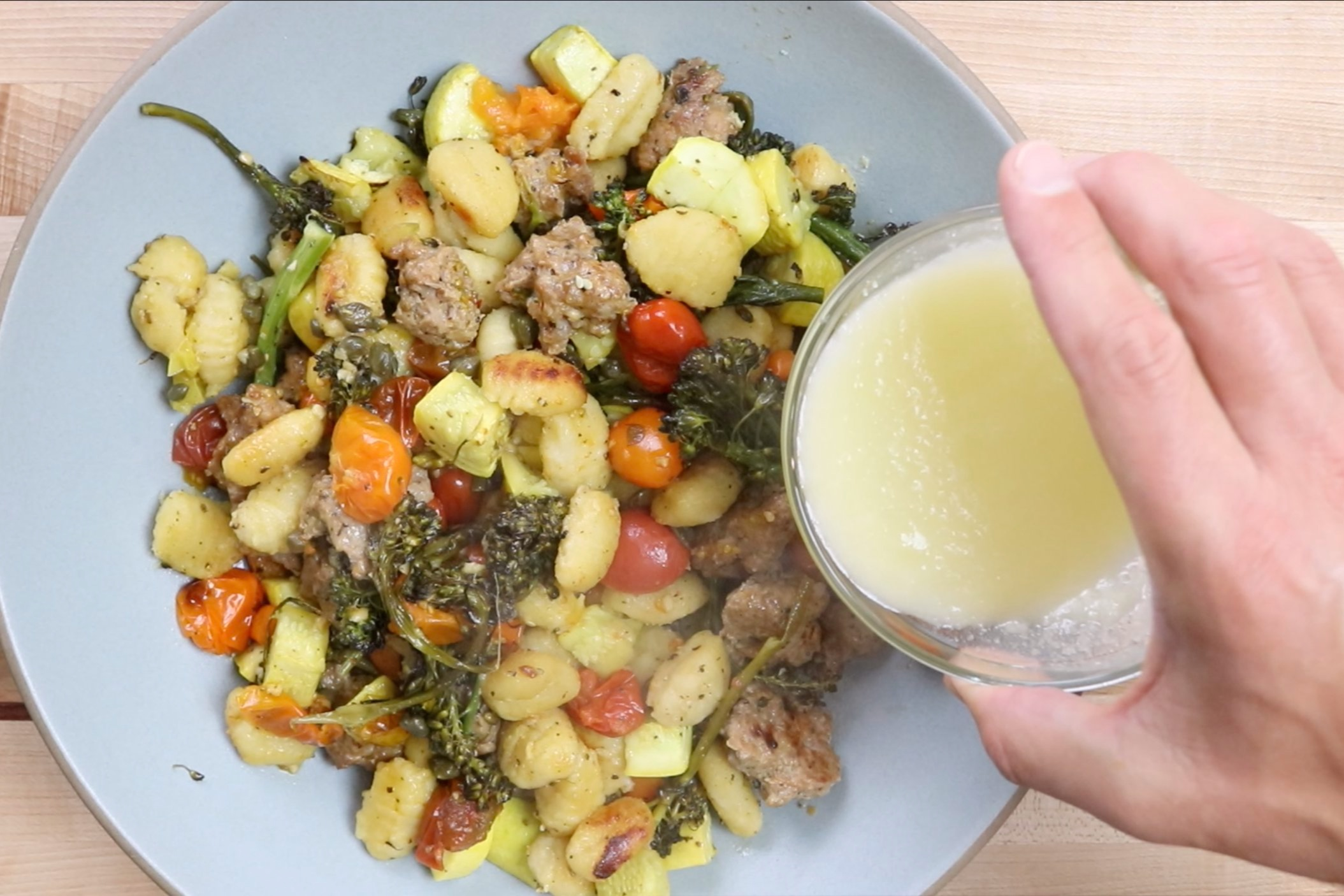 7. Add lemon juice and butter and stir with hot gnocchi and veggies. -
