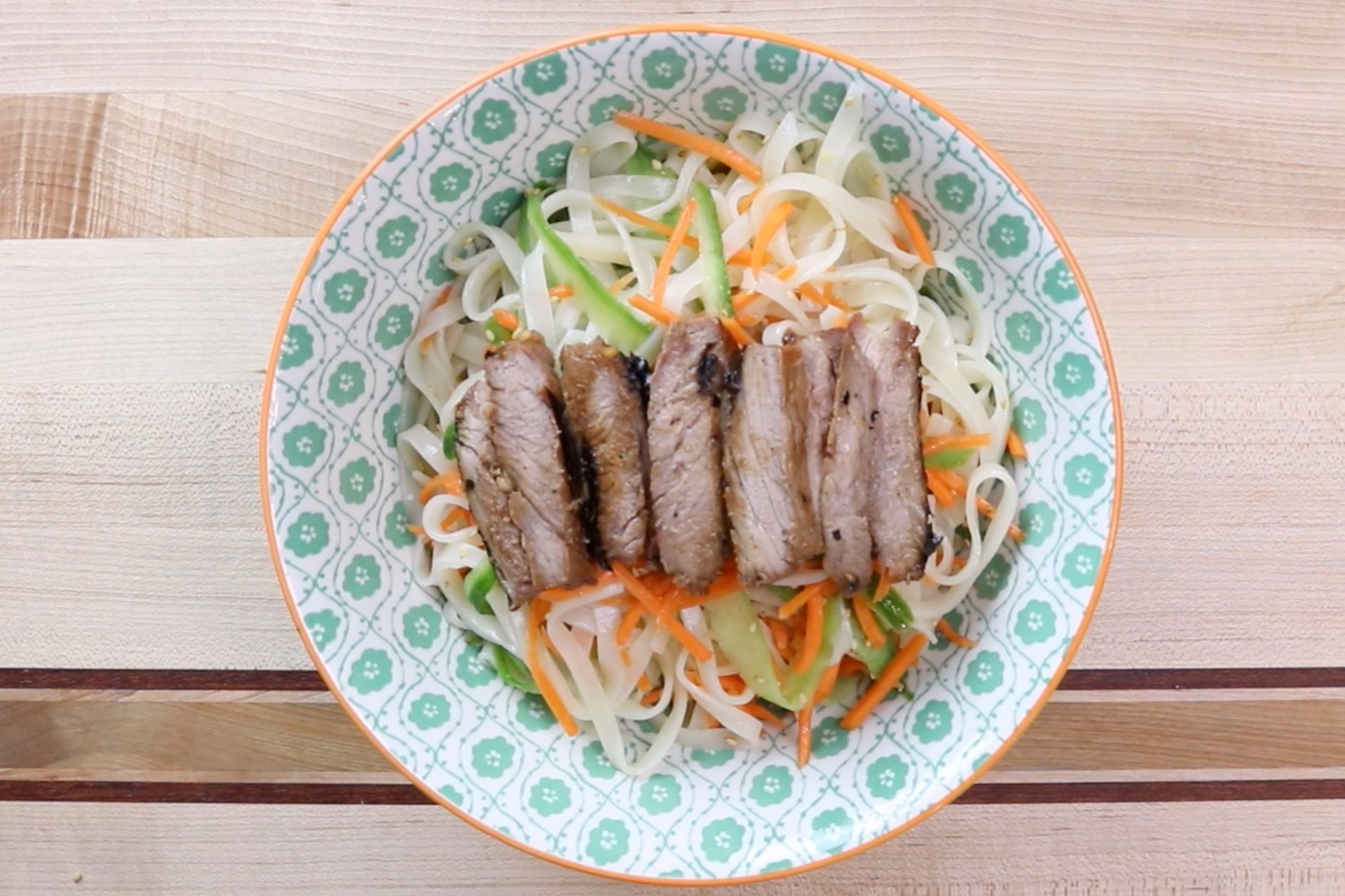 9. Slice steak into thin strips and lay on top of salad. -