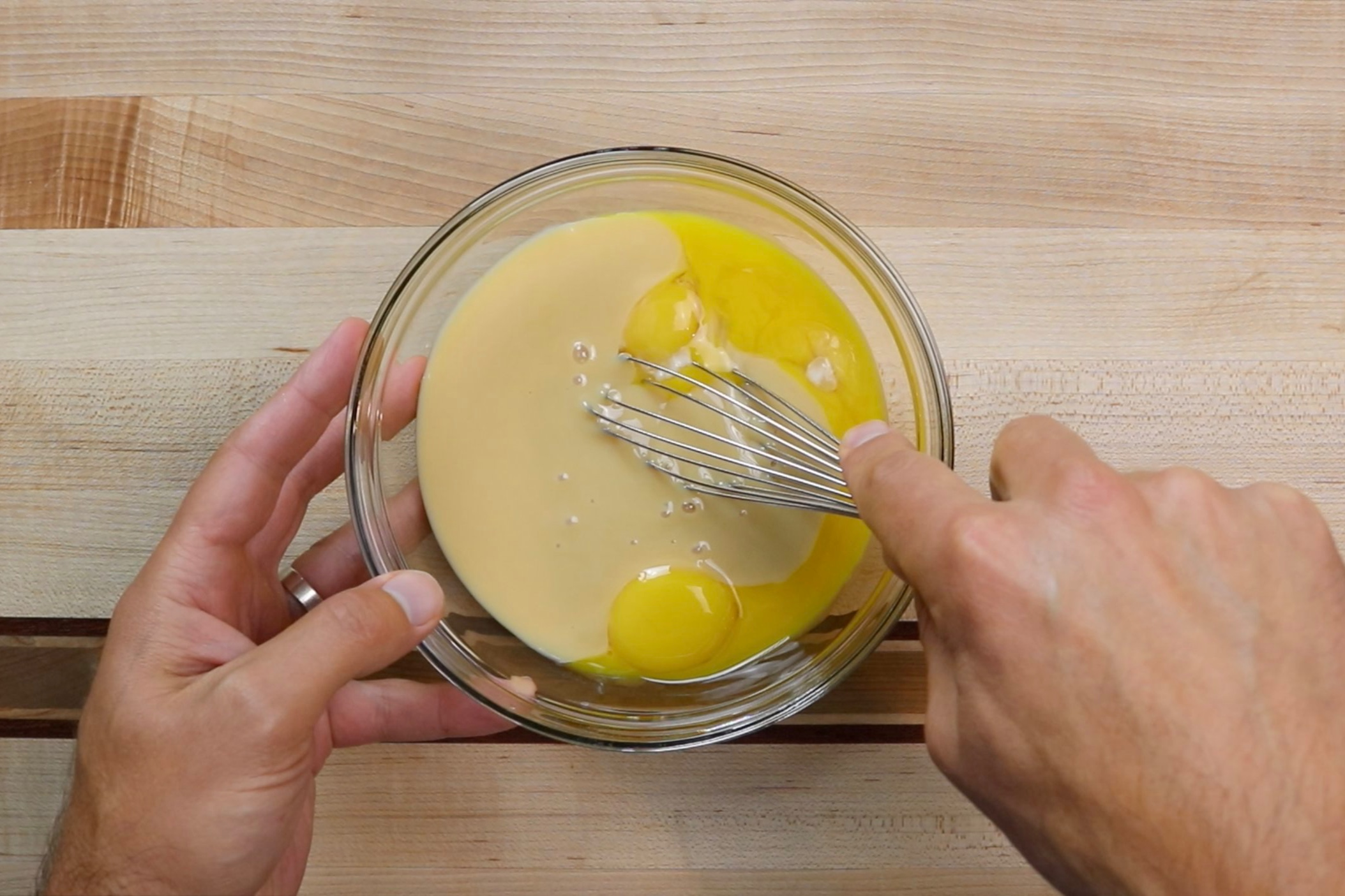 2. In a medium bowl, add the egg yolks and sweetened condensed milk. Whisk until combined. Set aside. -