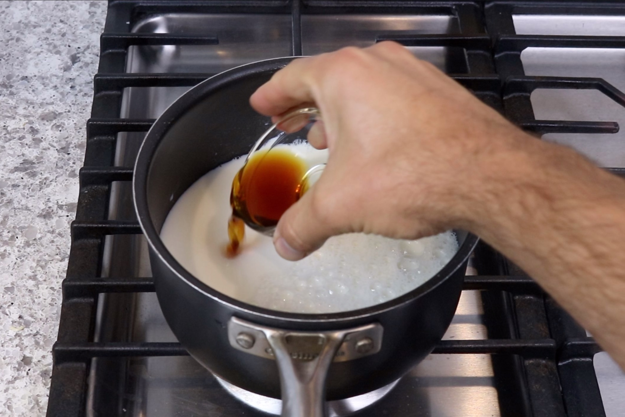 3. Add half (1 1/2 cups) of the milk and the vanilla to a large saucepan. Heat over medium heat stirring constantly until mixture is just about to boil. Around 2-3 minutes. -