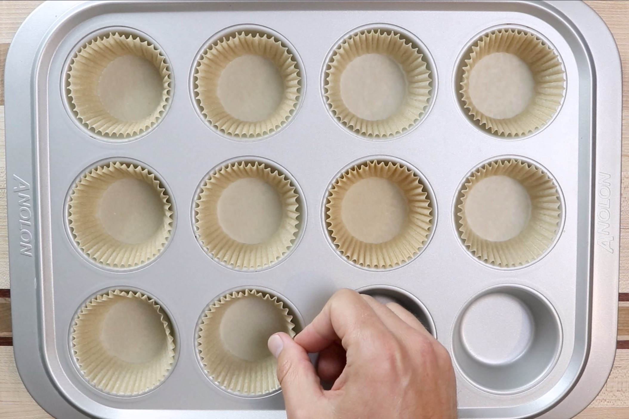 9. Line a 12-count muffin tin with baking cups. -