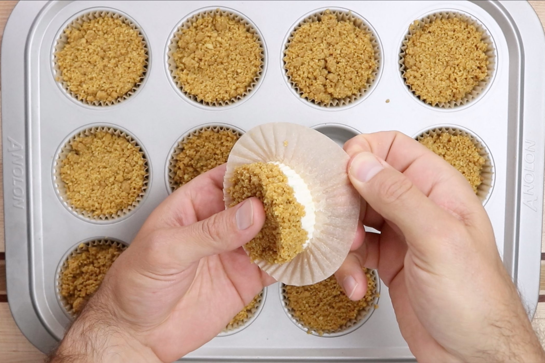 13. Gently remove the pies from the baking cups and place them graham cracker side down. -