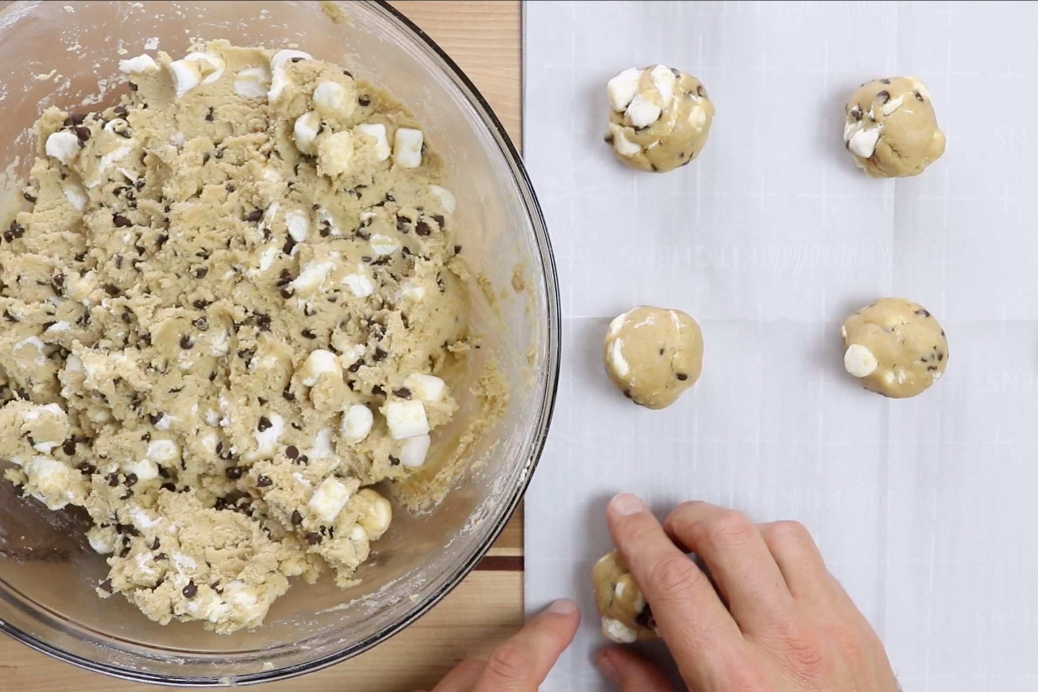9. Drop teaspoon sized balls of dough on a parchment lined baking sheet. -