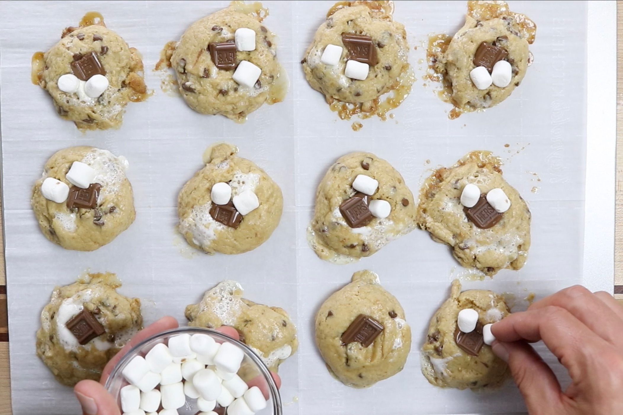 11. Add extra marshmallows and milk chocolate pieces to cookies if desired. -