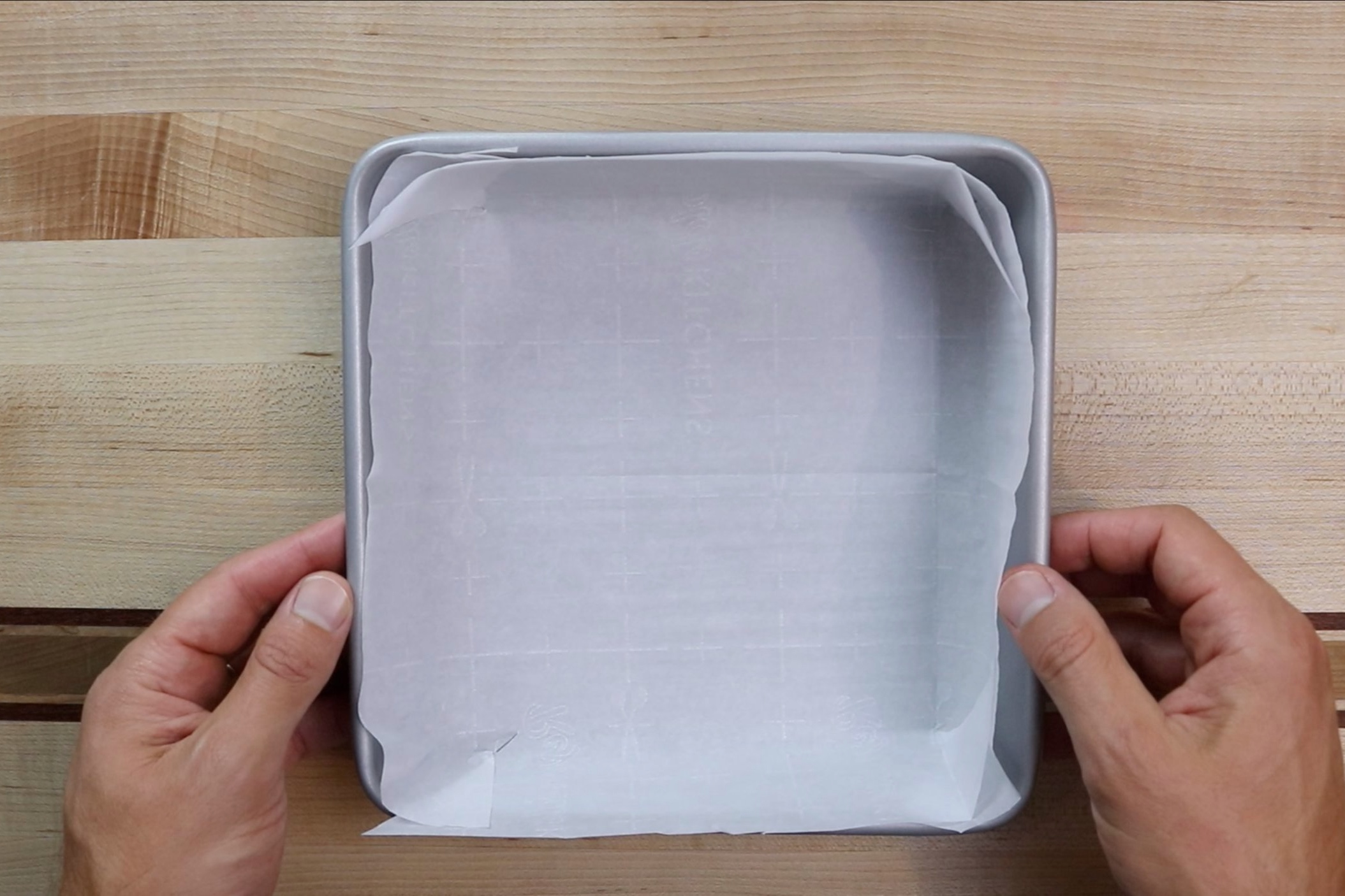 1. Preheat oven to 350 degrees. Line a 9x9 baking pan with parchment paper and grease with baking spray. -